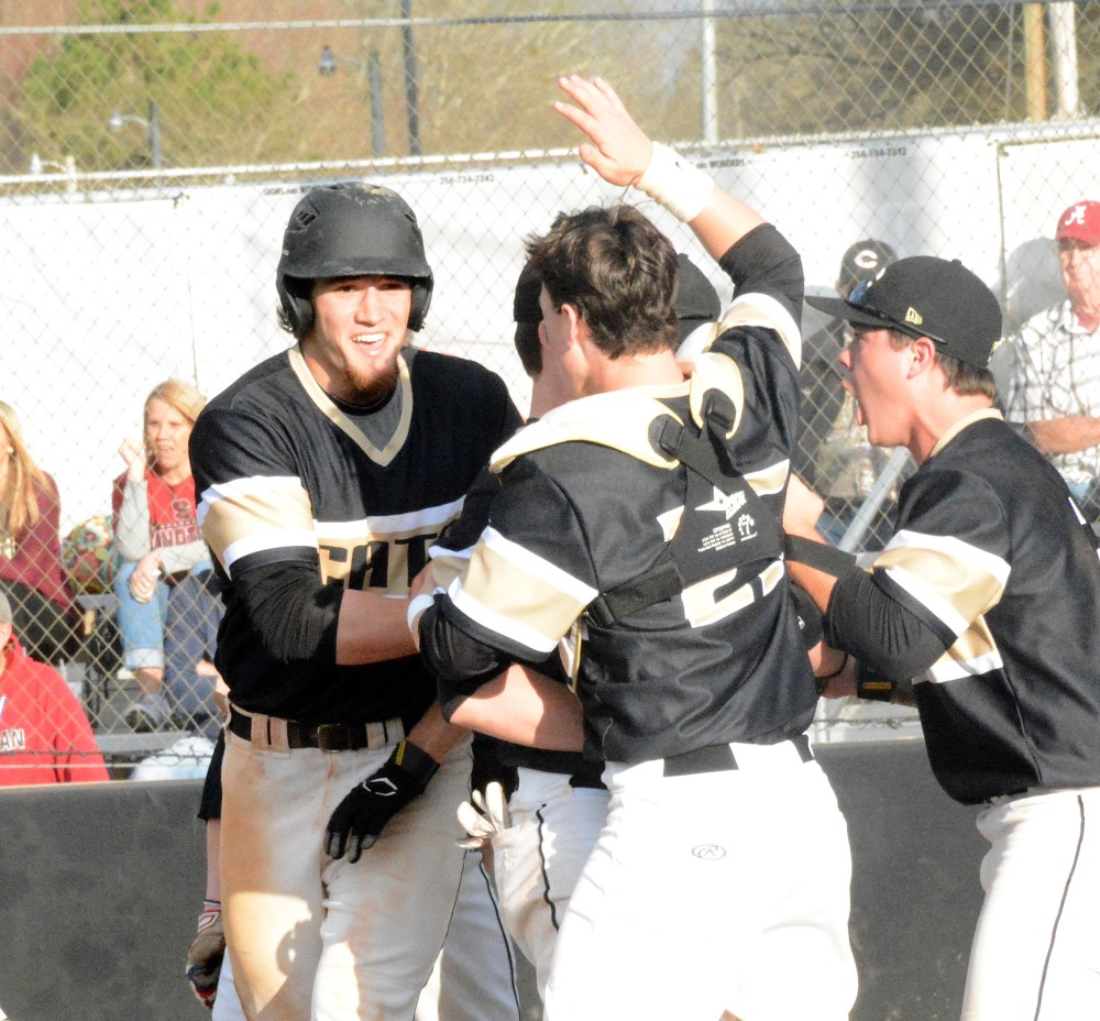 Cullman's Owen Lovell celebrates with teammates after stealing homer with the winning run. (Photo: Rob Ketcham/The Cullman Times).