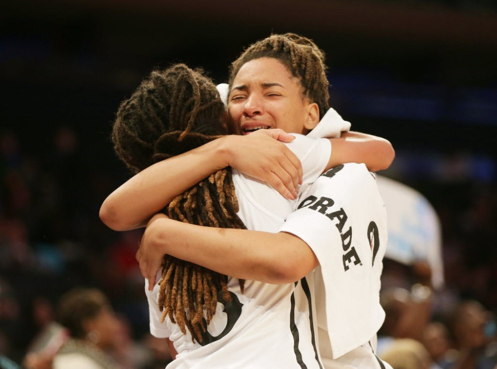 Ribault guard Nola Carter (13) cannot hold back her emotions as she hugs teammate Kayla Rogers (3) after defeating Riverdale Baptist 75-49 to win the national championship during Dick's Sporting Goods High School Basketball Nationals at Madison Square Garden. (Photo: Andy Marlin USA TODAY Sports Images).