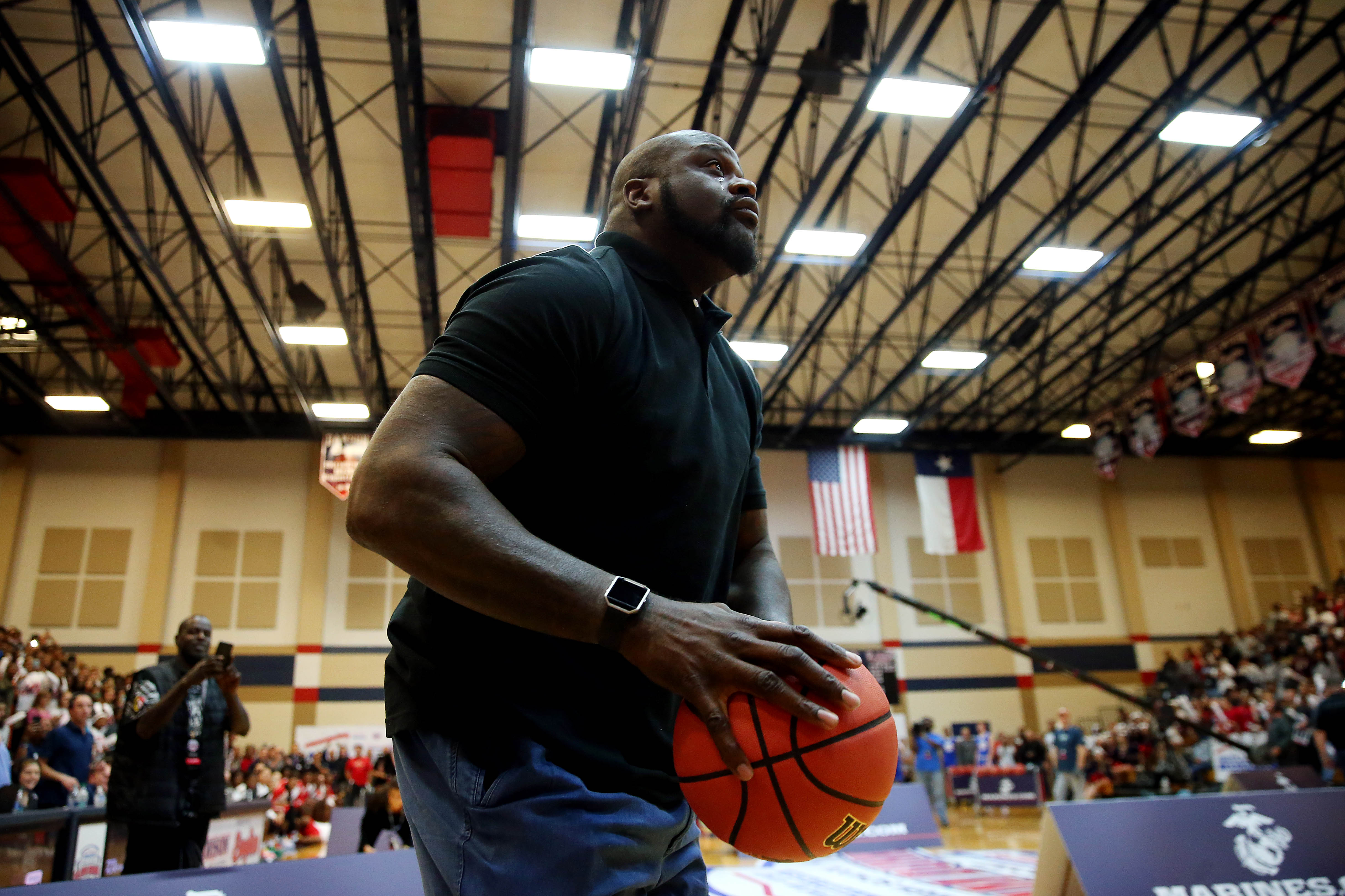 Shaquille O'Neal shoots the ball during the American Family High School Slam and 3-point championship at Dawson High School. Mandatory credit: Peter Casey-USA TODAY Sports ORIG FILE ID: 20160401_pjc_bc1_021.JPG