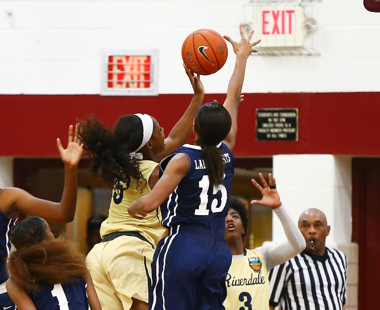 St. Francis guard Maya Dodson (14) defends on a shot by Riverdale Baptist forward Kaila Charles (5). (Photo: Andy Marlin, USA TODAY Sports)