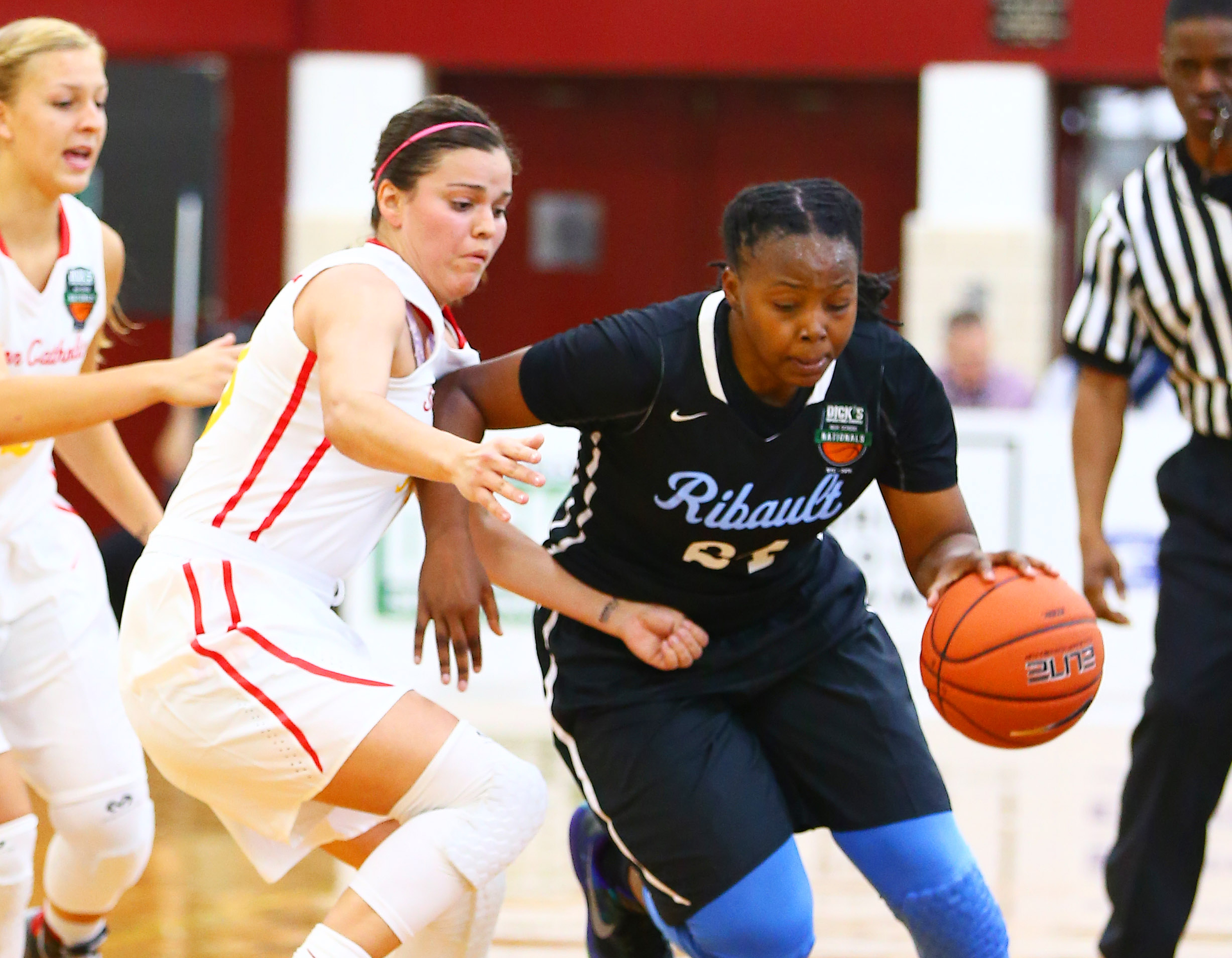 4/1/2016 1:00AM -- Middle Village, NY, U.S.A -- Seton Catholic guard Kendall Krick (33) defends against Ribault guard Day'neshia Banks (24) as she plays the ball during the first half during Dick's Sporting Goods High School Basketball Nationals at Christ the King Regional high school. -- Photo by Andy Marlin USA TODAY Sports Images, Gannett ORG XMIT: US 134676 Dick's basketbal 4/1/2016 [Via MerlinFTP Drop]
