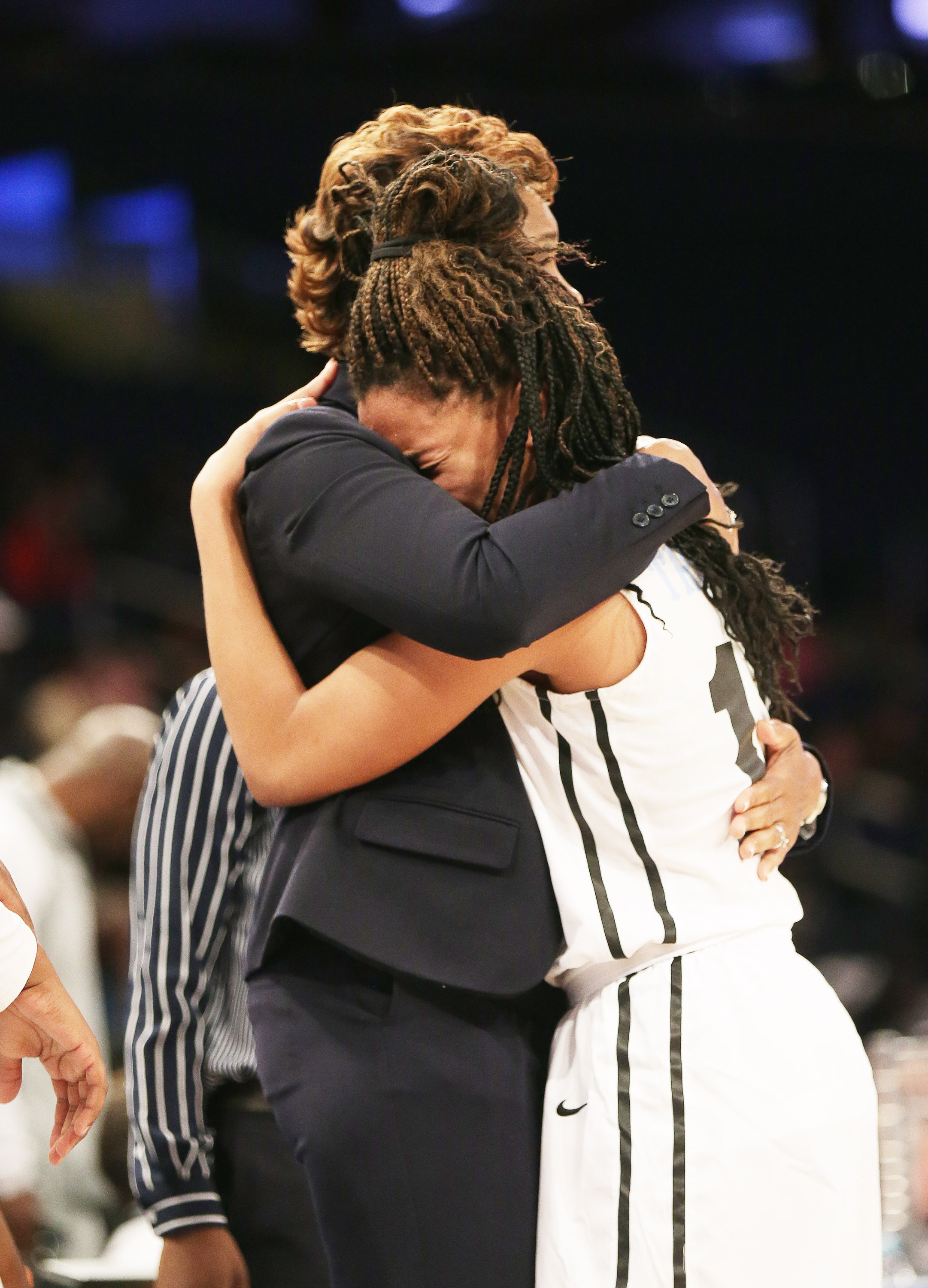 4/12/2016 10:00AM -- Middle Village, NY, U.S.A -- Ribault guard Nola Carter (13) cannot hold back her emotions as she hugs head coach Shelia Pennick after defeating Riverdale Baptist 75-49 to win the national championship during Dick's Sporting Goods High School Basketball Nationals at Madison Square Garden -- Photo by Andy Marlin USA TODAY Sports Images, Gannett ORG XMIT: US 134676 Dick's basketbal 4/1/2016 [Via MerlinFTP Drop]
