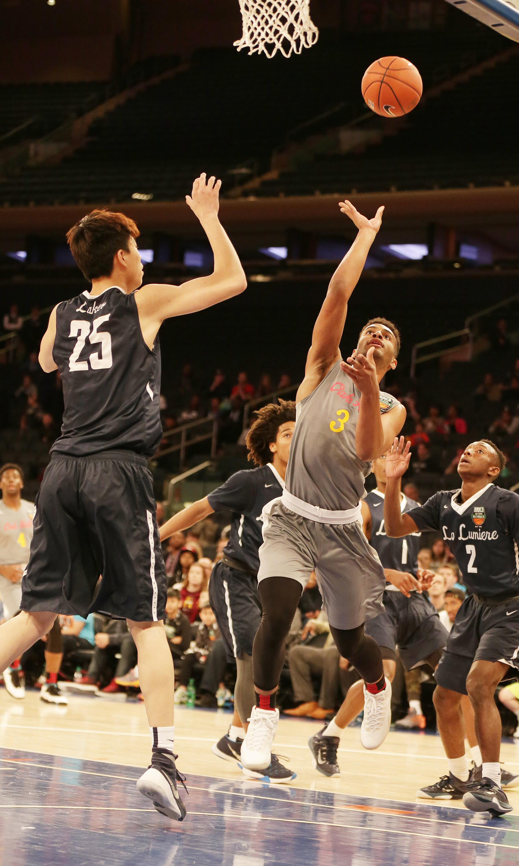 4/2/2016 12:00PM -- Middle Village, NY, U.S.A -- Oak Hill Academy forward Braxton Key (3) goes up for a shot against La Lumiere forward Kevin Zhang (25) during the first half during Dick's Sporting Goods High School Basketball Nationals at Madison Square Garden -- Photo by Andy Marlin USA TODAY Sports Images, Gannett ORG XMIT: US 134676 Dick's basketbal 4/1/2016 [Via MerlinFTP Drop]