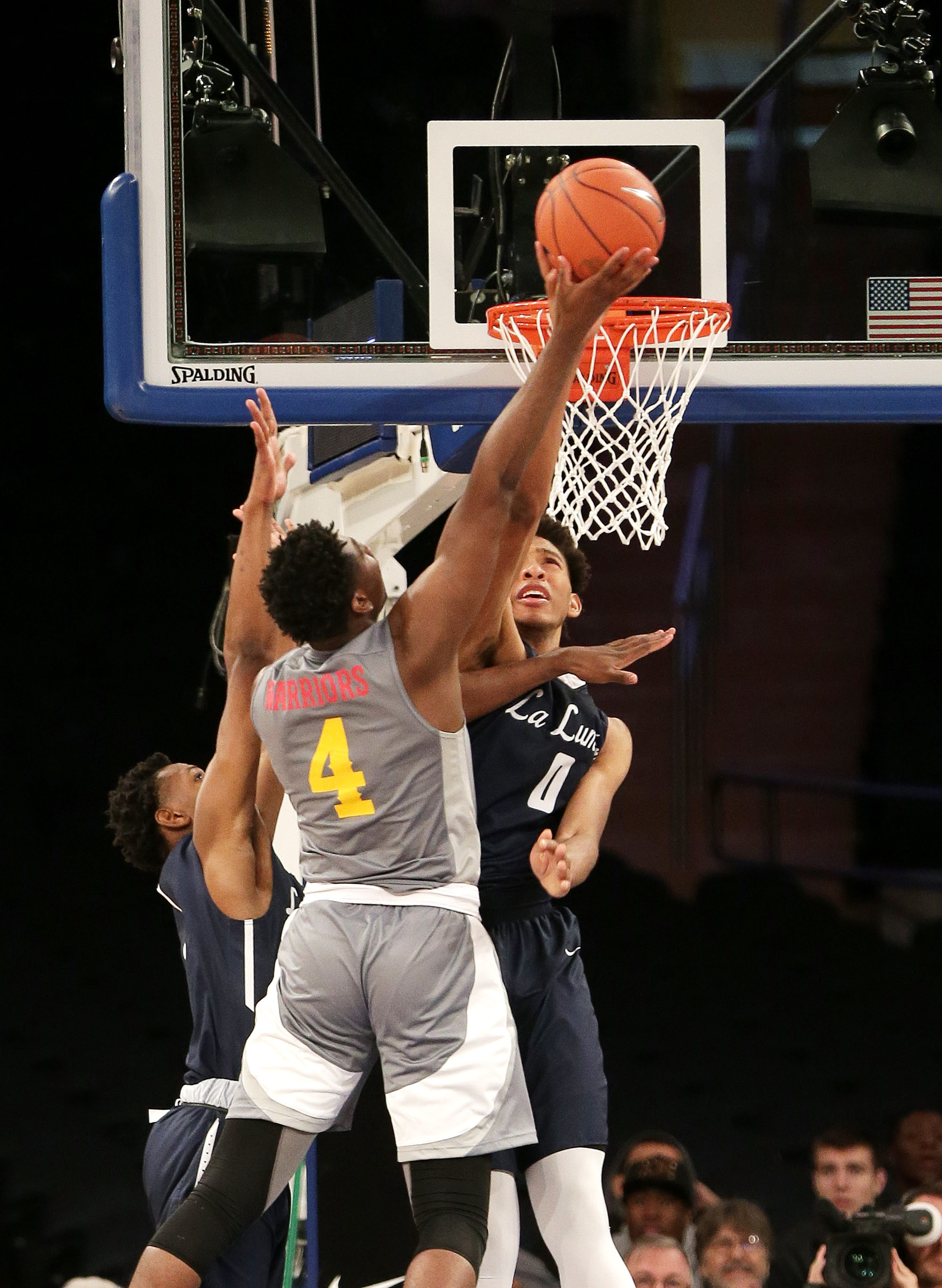 4/2/2016 12:00PM -- Middle Village, NY, U.S.A  -- Oak Hill Academy forward Mario Kegler (4) takes a shot while being defended by La Lumiere center James Banks (0) during the second half Oak Hill defeated La Lumiere in overtime 62-60 to win the national championship during Dick's Sporting Goods High School Basketball Nationals at Madison Square Garden -- Photo by Andy Marlin USA TODAY  Sports Images, Gannett ORG XMIT:  US 134676 Dick's basketbal 4/1/2016 [Via MerlinFTP Drop]