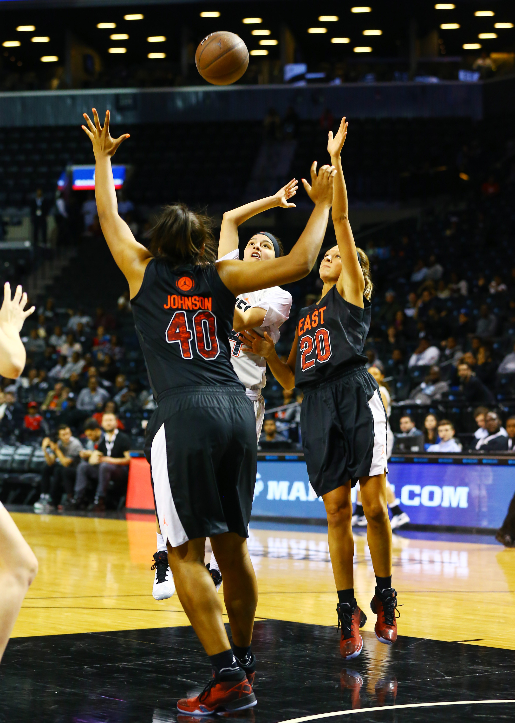 4/15/2016 3:30PM -- New York, NY, U.S.A  -- West Team guard Amber Ramirez (14) takes a shot while being defended by East Team guard Lindsey Corsaro (20) and center Ciera Johnson (40) during the second half of the Jordan Brand Classic Girls National Game at Barclay's Center.The West defeated the East 100-94. Photo by Andy Marlin-USA TODAY  Sports Images, Gannett ORG XMIT:  US 134691 Jordan hoops 4/15/2016 [Via MerlinFTP Drop]
