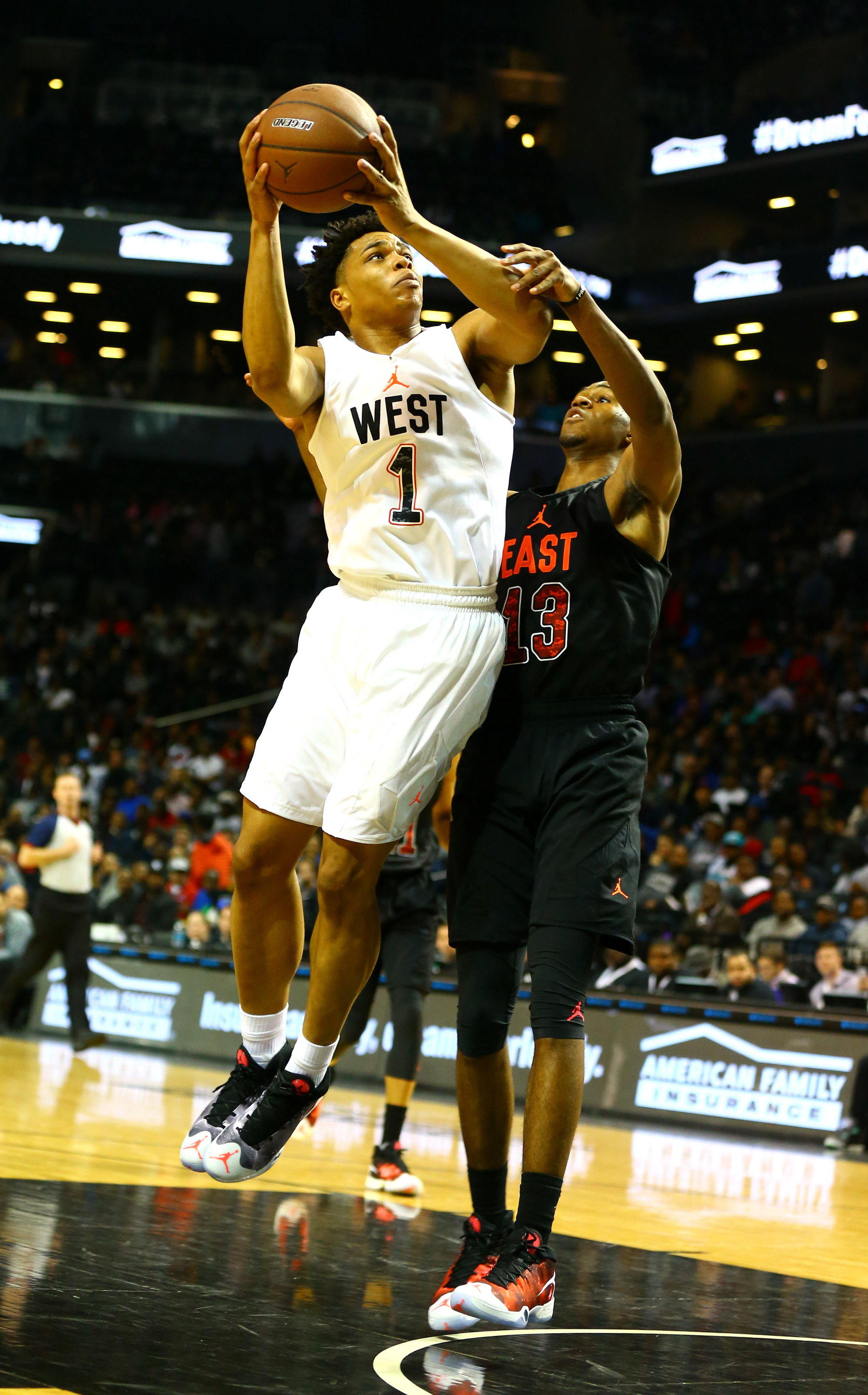 4/15/2016 8:00PM -- New York, NY, U.S.A -- West Team forward Miles Bridges (1) goes up for a shot while being defended by West Team forward Omari Spellman (13) during the second half of the Jordan Brand Classic Boys National Game at Barclay's Center.The East defeated the West 131-117. Photo by Andy Marlin-USA TODAY Sports Images, Gannett ORG XMIT: US 134691 Jordan hoops 4/15/2016 [Via MerlinFTP Drop]
