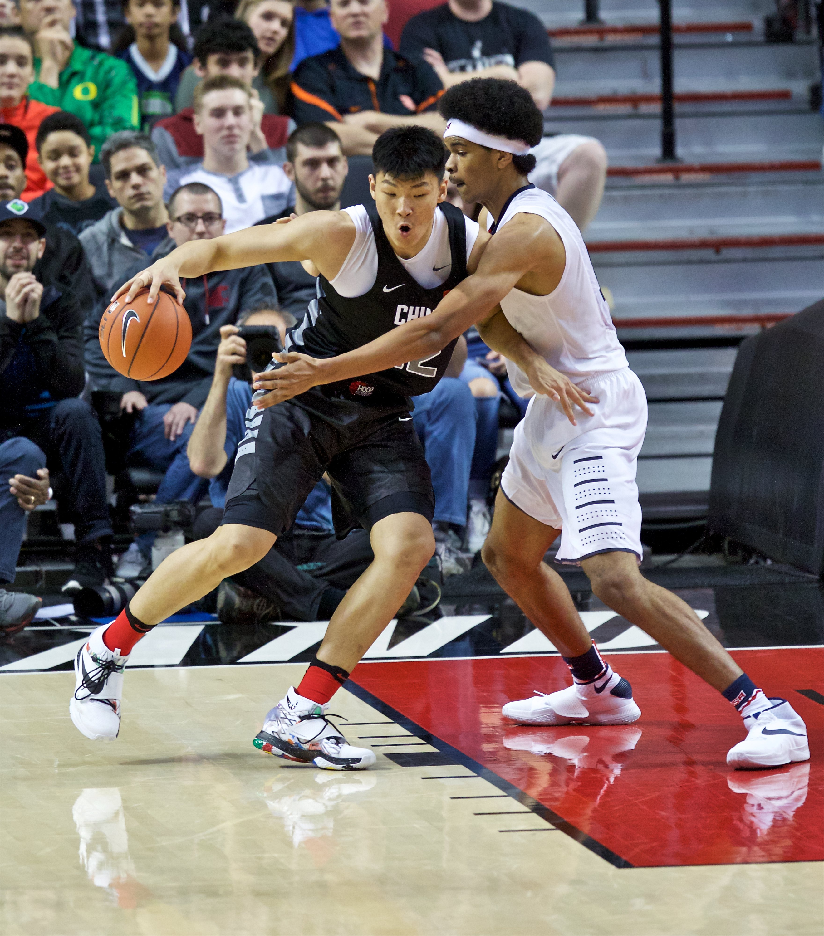 World center Ziming Fan, left, posts up against USA's Jarrett Allen, right, during the first half of the Nike Hoop Summit preps basketball game. -- Photo by Craig Mitchelldyer-USA TODAY Sports Images, Gannett ORG XMIT: US 134692 Nike hoops 4/9/2016 [Via MerlinFTP Drop]