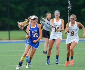 Kentucky Country Day's Madison Mitzlaff (32) fights pressure from Louisville Collegiate's Elle Summerfield (9) and Alex Oldham (13) during the first half of the Girls Lacrosse State Finals in Louisville, Kentucky. May 25, 2015