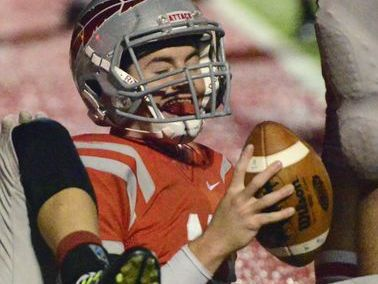 Bellevue's Alec Foos smiles after scoring a touchdown against Shelby this season.