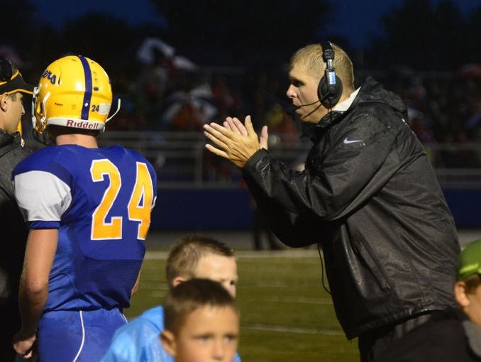 Clyde High School football coach Ryan Carter claps on the sideline during a game this season.