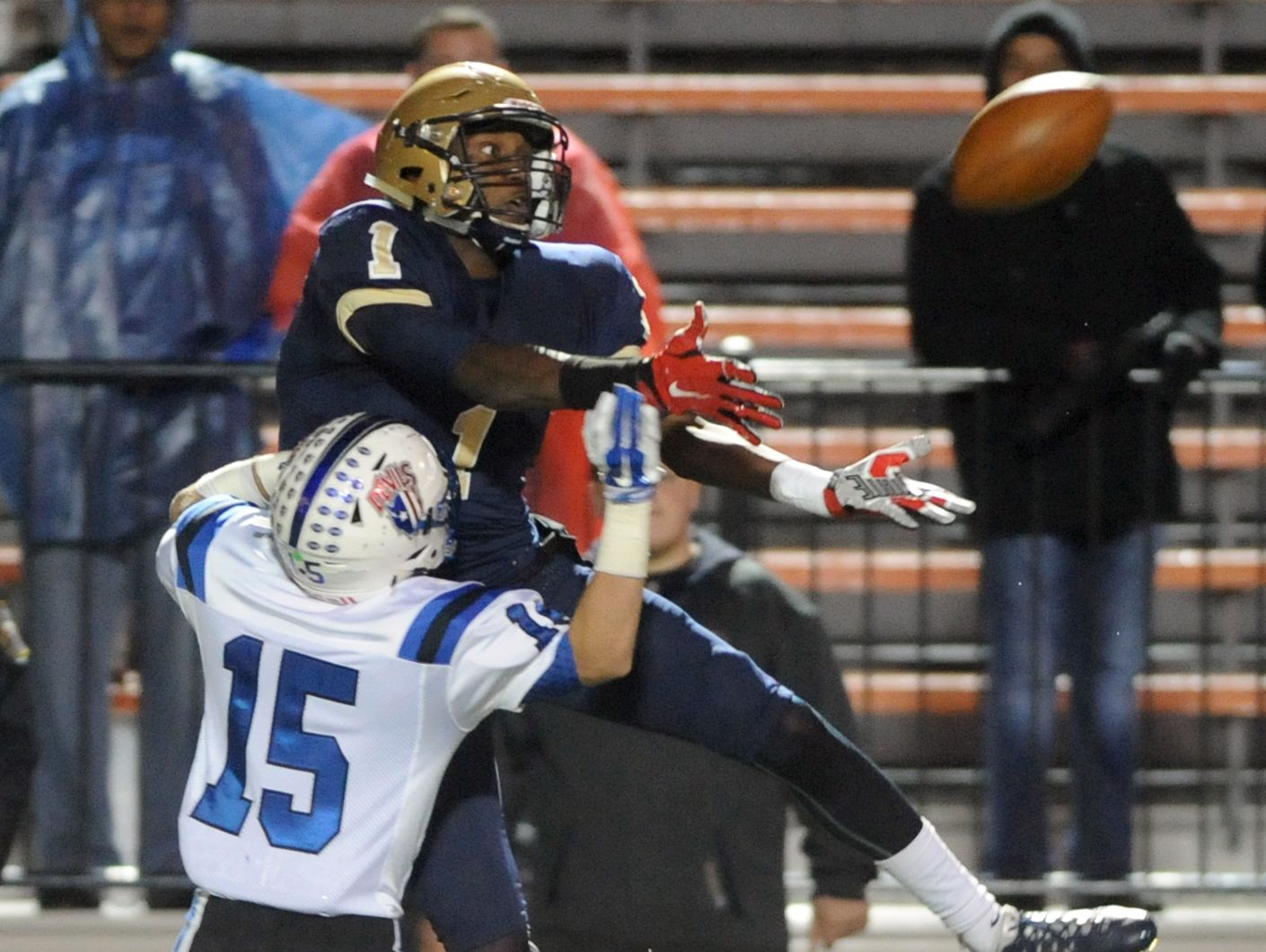 Zanesville's Ben Kaufman defends Akron Hoban's Jonah Morris as Morris leaps to make a catch during the Blue Devils' 33-21 Division III state semifinals loss Friday night in Massillon.
