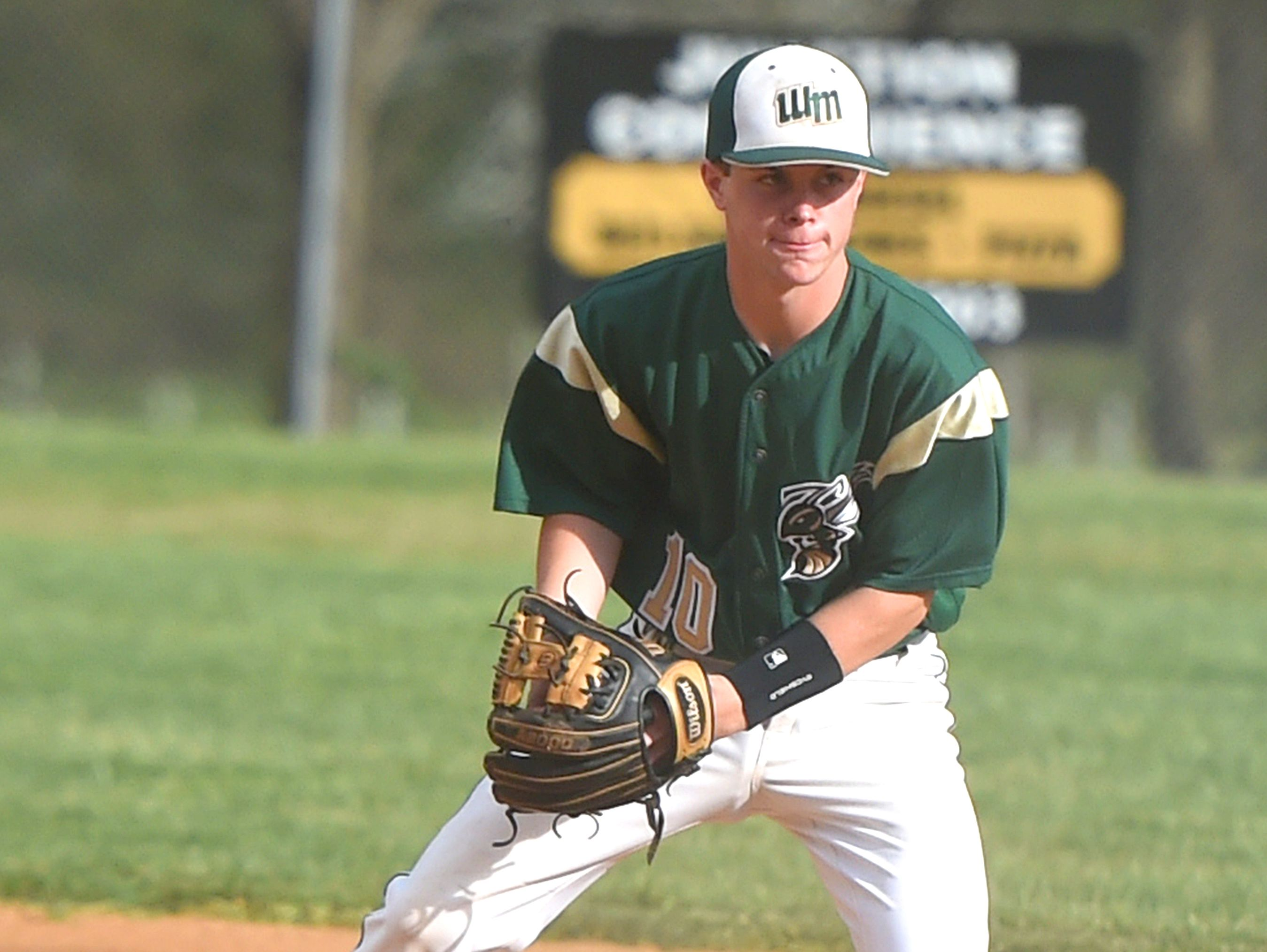 Wilson Memorial's Gage Wood fields a grounder in the first inning in of the Green Hornets' game against Buffalo Gap on April 26.