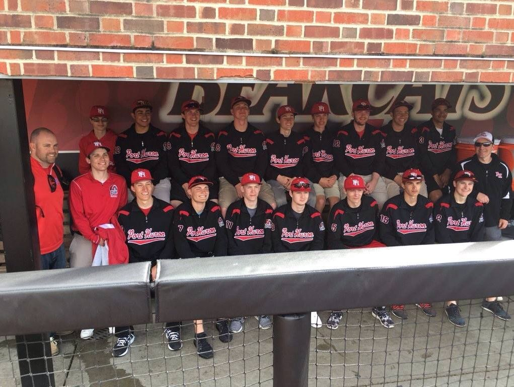 Port Huron's baseball team poses in University of Cincinnati's dugout during a tour of their athletic facilities.