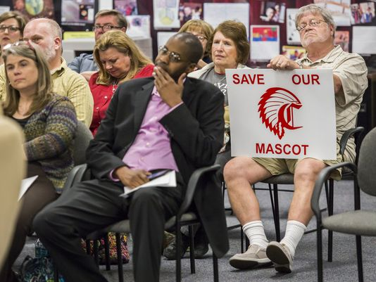 "Tim Laushey, a 1967 Conrad High School graduate and alumni band director, holds a sign reading ""Save Our Mascot,"" at a meeting over the use of the Redskins logo in Elsmere on Monday. A committee is suggesting to change the logo. (Photo: Kyle Grantham, the News Journal.)"