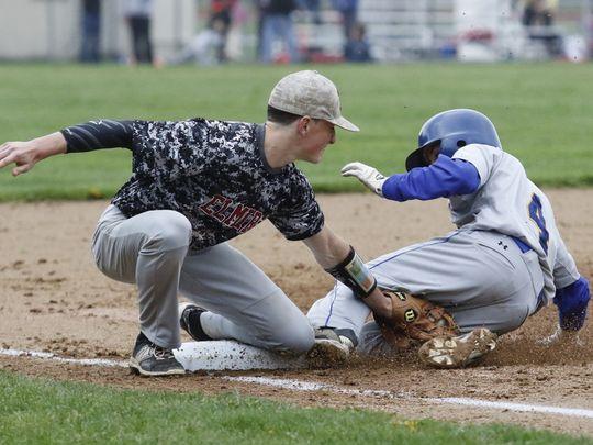Elmira third baseman Matt Lovejoy tags Maine-Endwell's Chris McVannan at third base during the Express' 1-0 victory. (Photo: Andrew Legare, Star-Gazette)