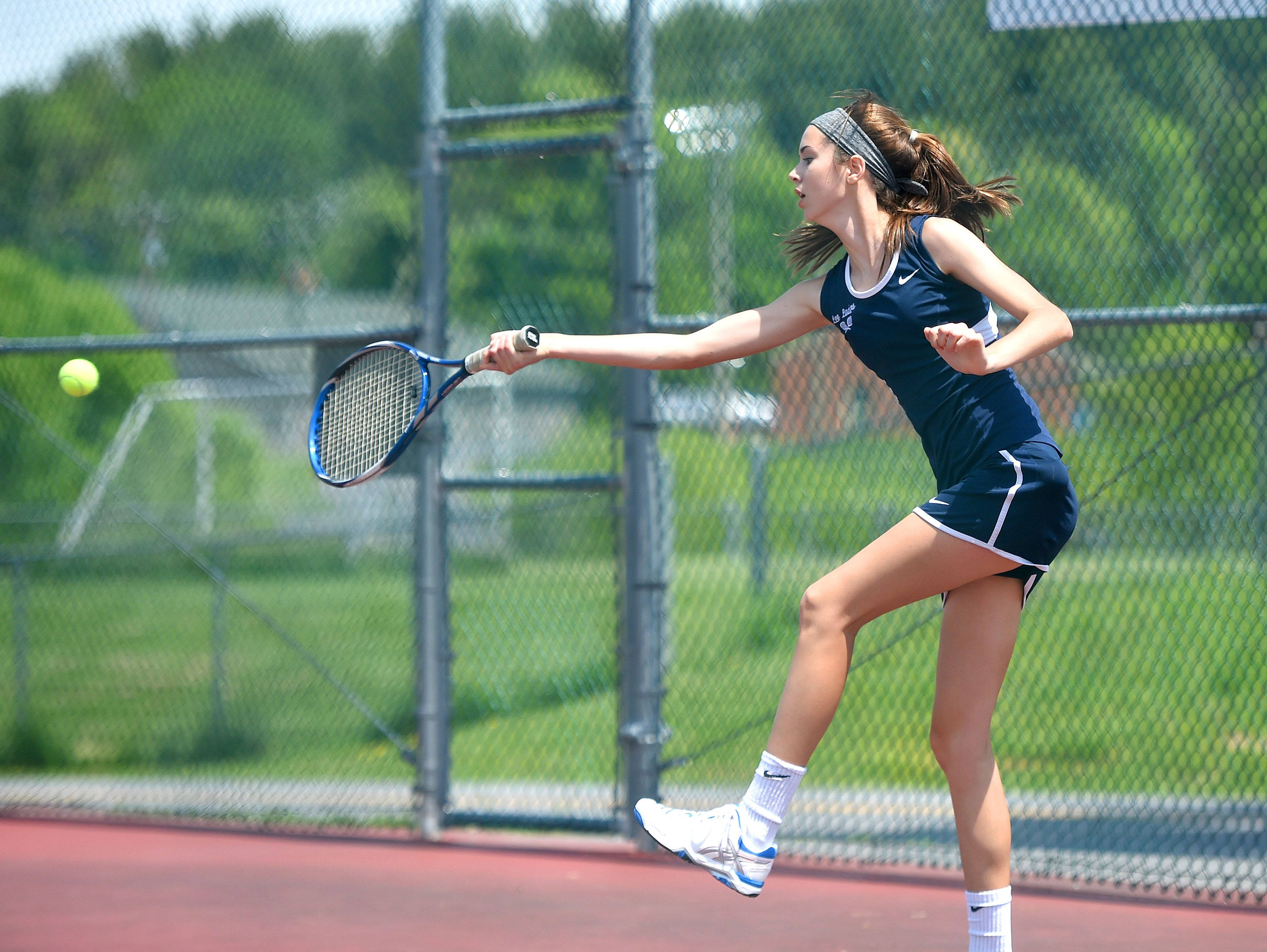 Robert E. Lee's Jennifer Williams gets to the ball for a return in a match against Stuarts Draft's Grace Cheung during the Conference 36 tennis tournament in Fishersville on Thursday, May 13, 2016.