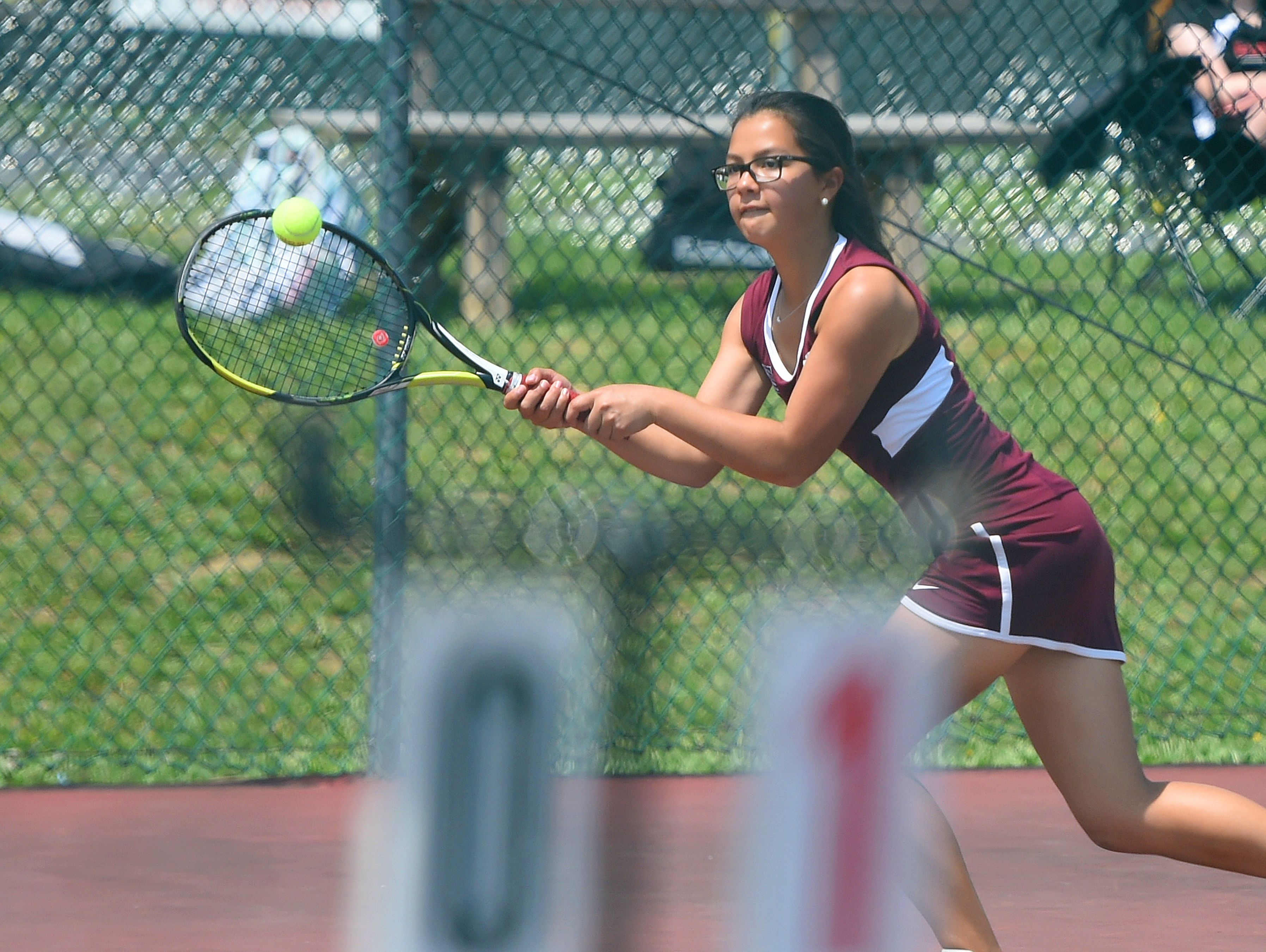 Stuarts Draft's Grace Cheung slips sideways to the ball to make the return in a match against Robert E. Lee's Jennifer Williams during the Conference 36 tennis tournament in Fishersville on Thursday, May 13, 2016.