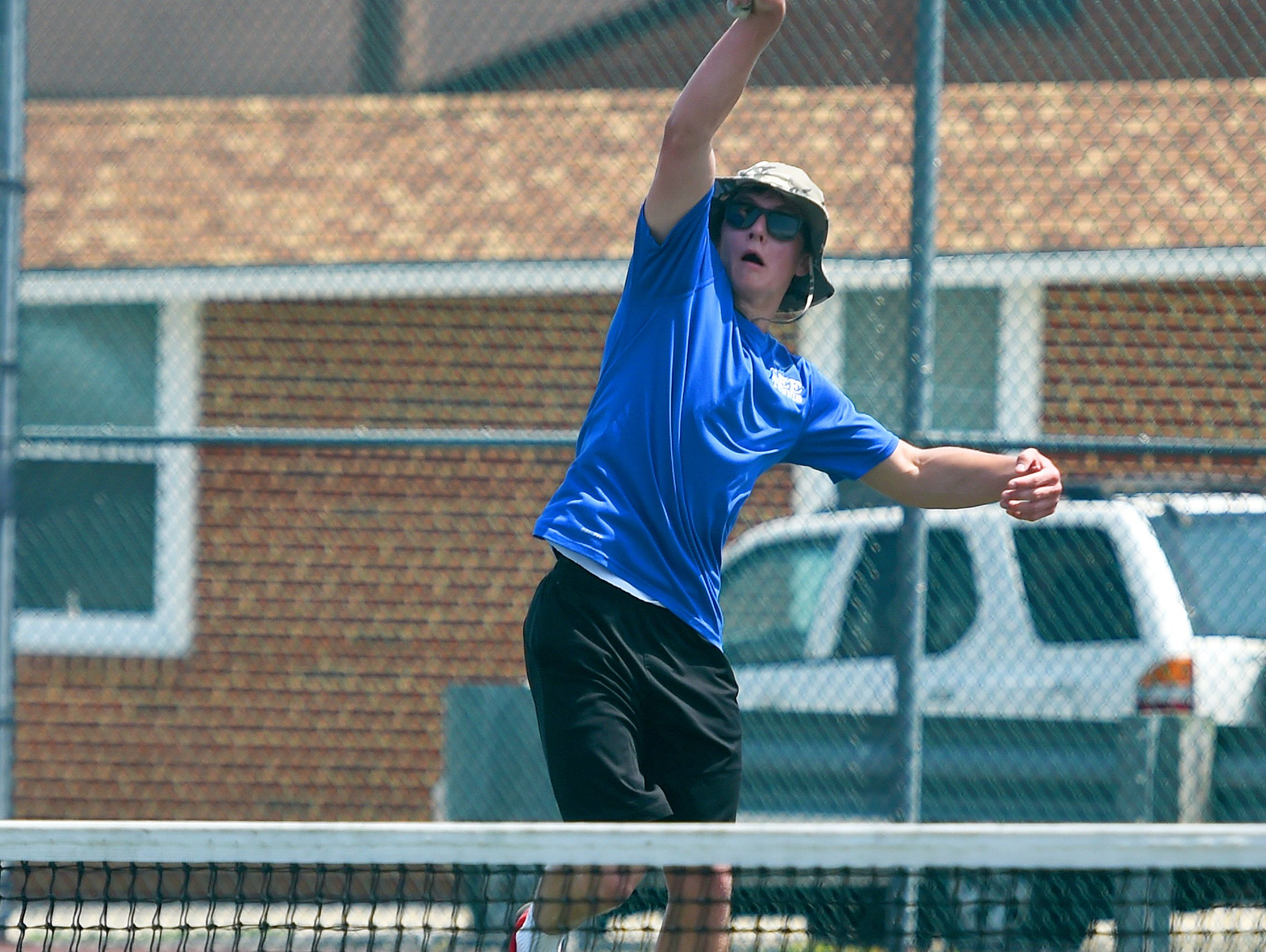 Robert E. Lee's Mark Silwoski goes high to make the return in a match against Riverheads' Eric Alanko during the Conference 36 tennis tournament in Fishersville on Thursday, May 13, 2016.