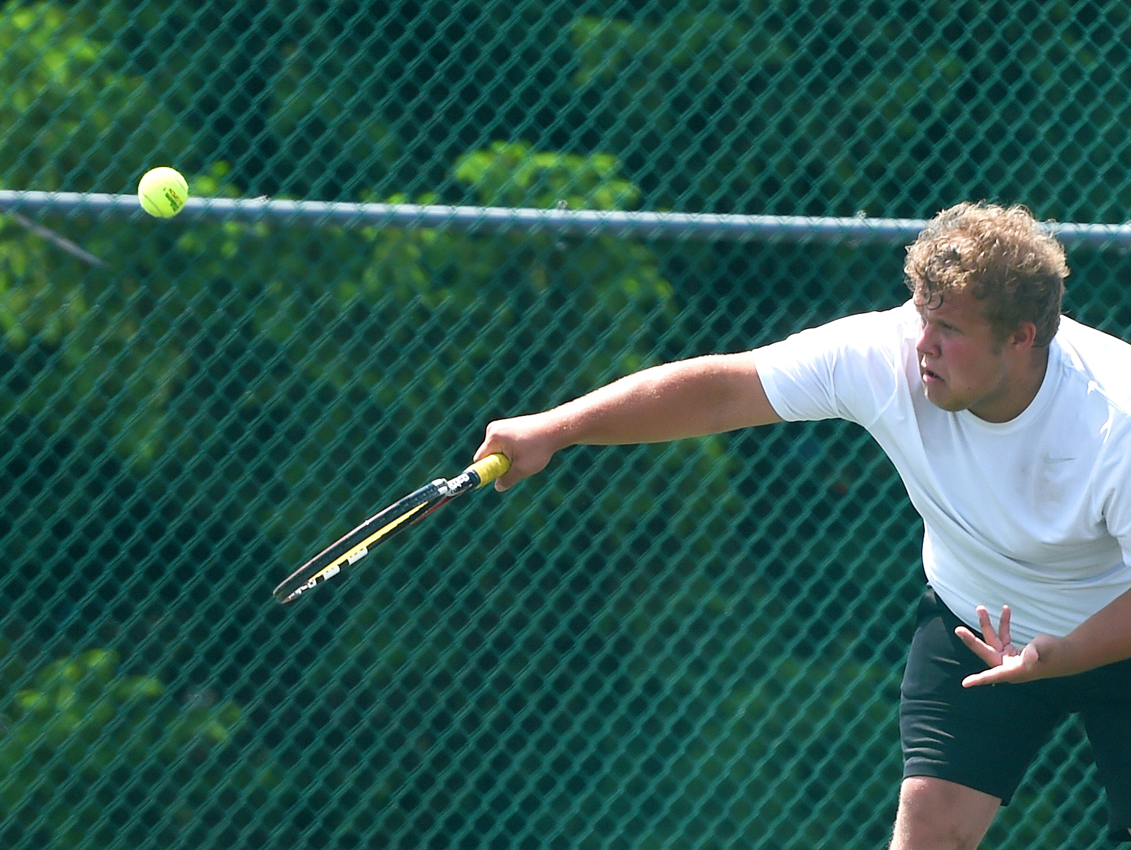 Buffalo Gap's Clay Graham serves the ball in a match against East Rockingham's Jordan Secrist during the Conference 36 tennis tournament in Fishersville on Thursday, May 13, 2016.