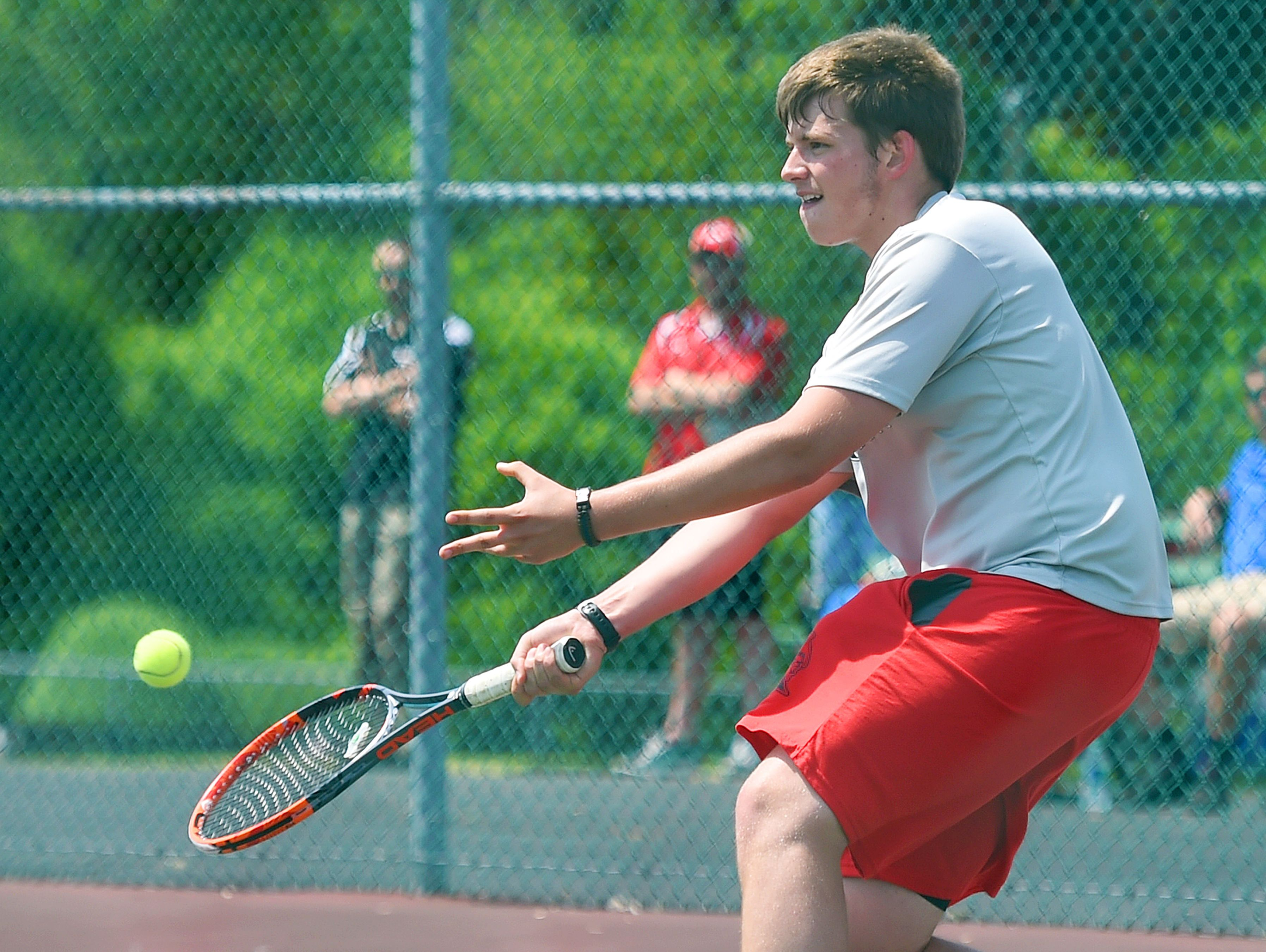 Riverheads' Eric Alanko slips forward to make the return in a match against Robert E. Lee's Mark Silwoski during the Conference 36 tennis tournament in Fishersville on Thursday, May 13, 2016.