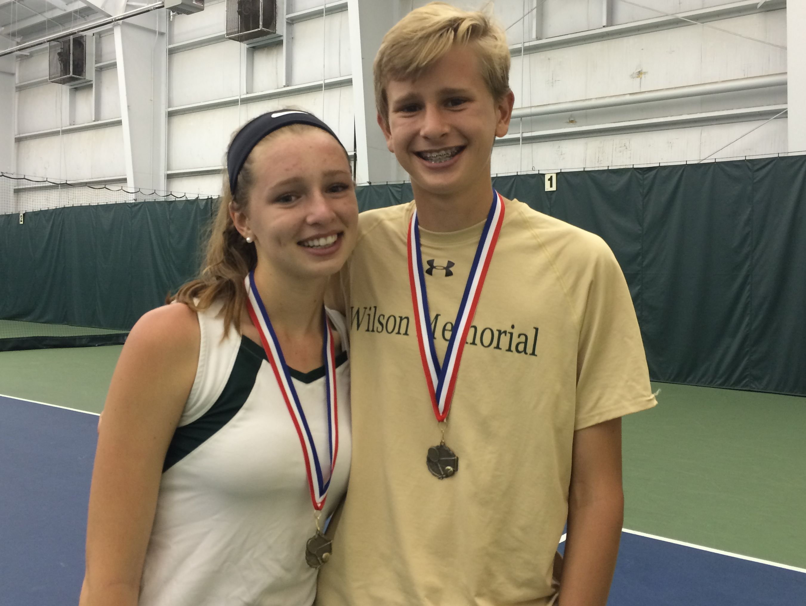 Wilson Memorial's Landon Aud, left, and brother Ryan pose with their medals after winning their respective Conference 36 singles title Thursday at Augusta Health's Lifetime Fitness Center.