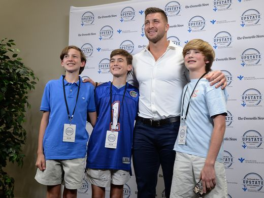 Tim Tebow posing before delivering a speech at the Greenville News Upstate Sports Awards Monday. (Photo: Bart Boatwright, Greenville News)