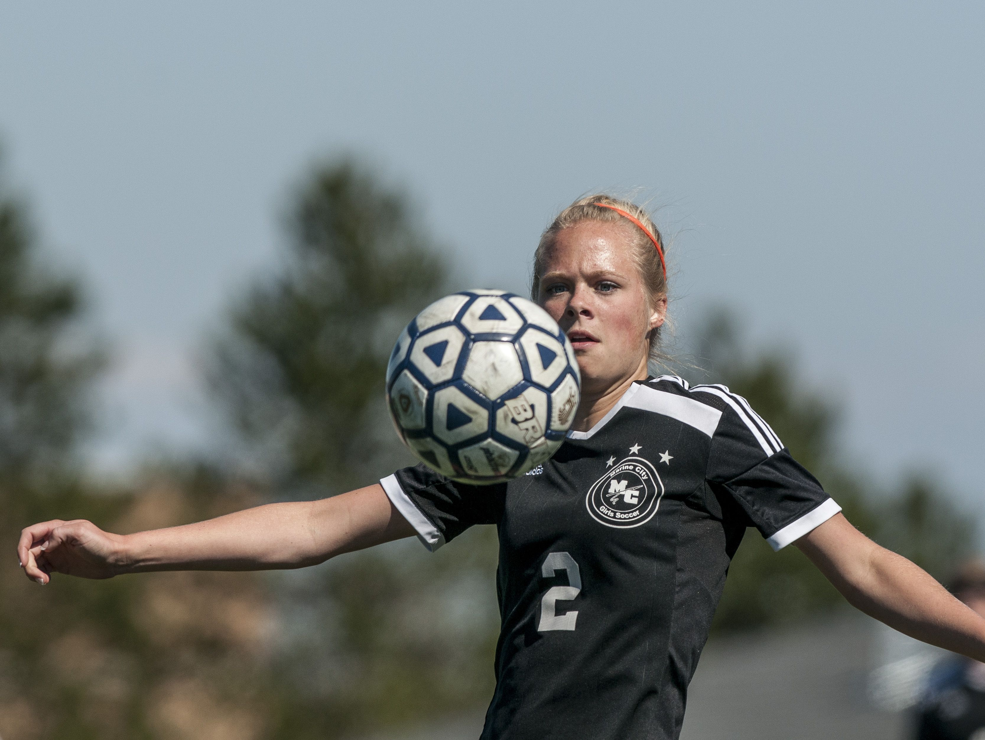 Marine City senior Bailee Gunderson controls the ball during a soccer game Wednesday, May 18, 2016 at Marysville High School.