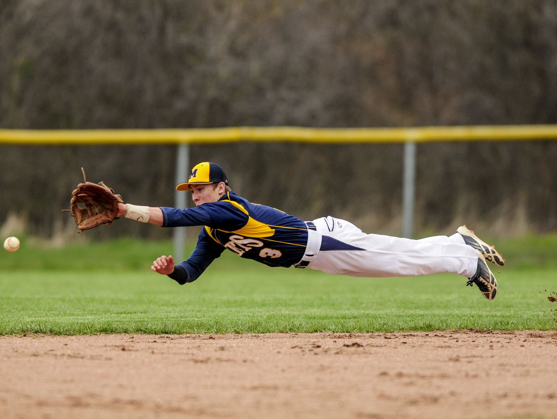 Memphis' Dillon Mitchell leaps for the ball but narrowly misses during a baseball game Thursday, April 28, 2016 at Armada High School.