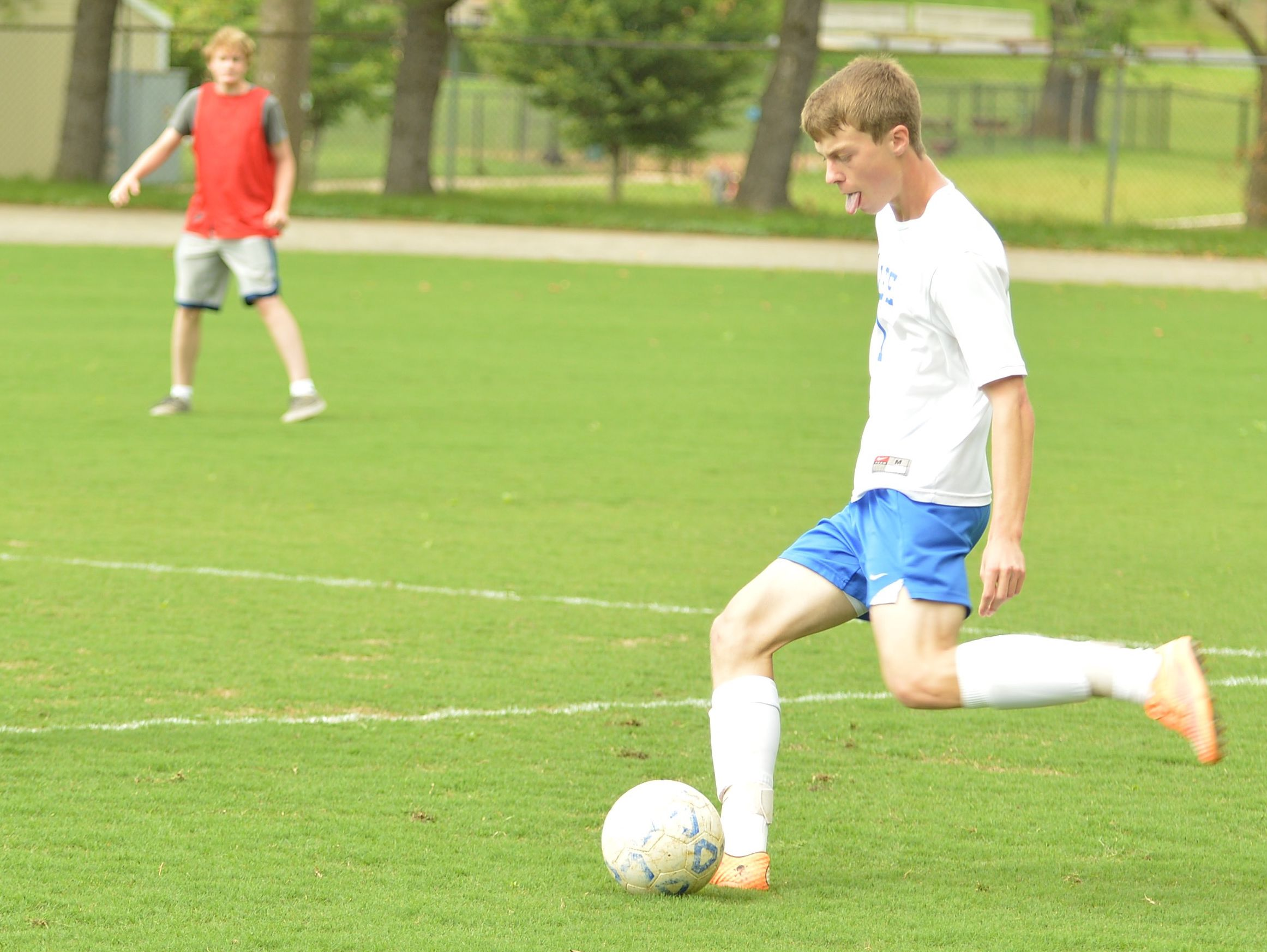 Kyle Stenzel attempts a cross in the first half of the Region 2A East Tournament.