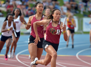 Jun 5, 2015; Clovis, CA, USA; Lauren Rain Williams takes the handoff from Schuyler Moore on the anchor leg of the Oaks Christian girls 4 x 100m relay that ran the top qualifying time of 45.79 in the 97th CIF State Track and Field Championships at Veterans Memorial Stadium. Mandatory Credit: Kirby Lee-USA TODAY Sports ORG XMIT: USATSI-225770 ORIG FILE ID: 20150605_gma_al2_219.jpg