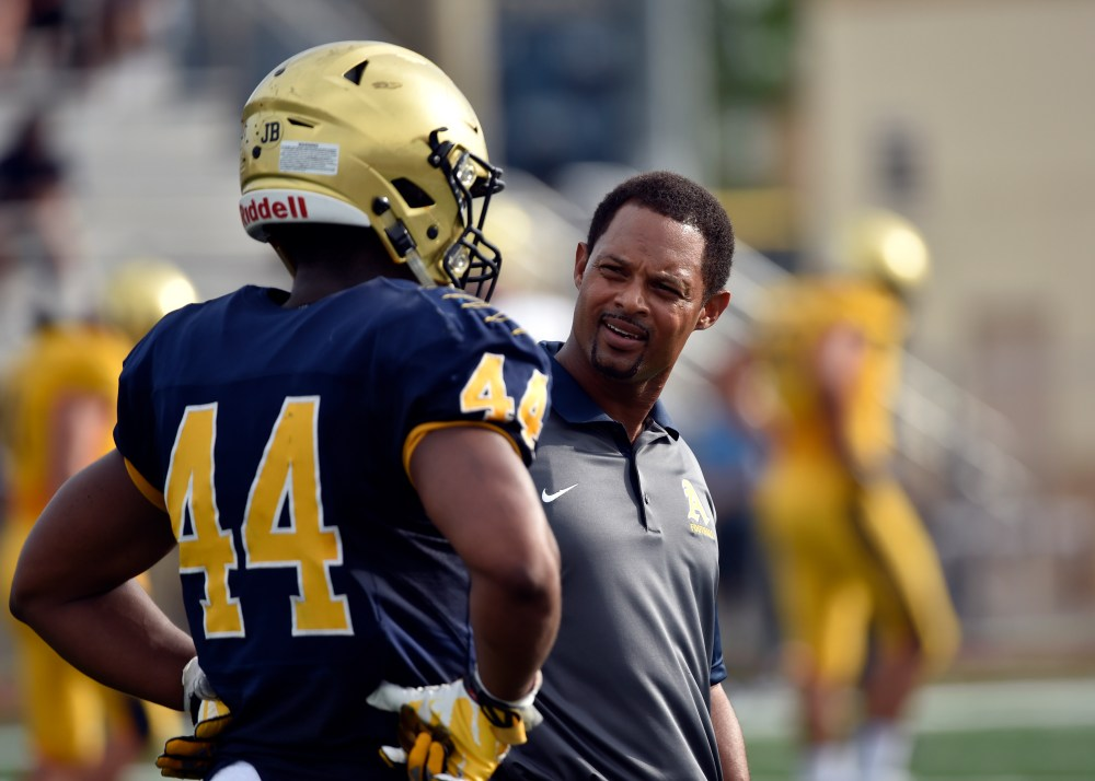 May 19 2016 -- Fort Lauderdale, FL, U.S.A -- St. Thomas Aquinas head coach Roger Harriott (left) talks with Aquinas linebacker Derrell Shelton (right). St. Thomas Aquinas, the likely No. 1 team in the preseason Super 25, is hosting its annual gold and blue inter squad scrimmage at the school's stadium. -- Photo by Steve Mitchell USA TODAY Sports Images, Gannett ORG XMIT: US 134928 St. Thomas Aquin 5/19/2016 [Via MerlinFTP Drop]