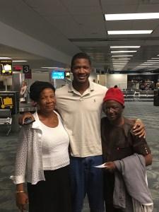 Elochukwu Eze with his parents. (Photo: Geoff Still)