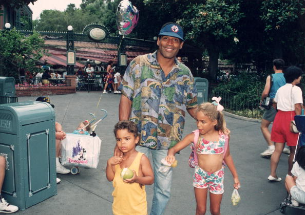 Former professional football player O. J. Simpson with children Justin and Sydney (R) at Disneyland. (Getty Images)