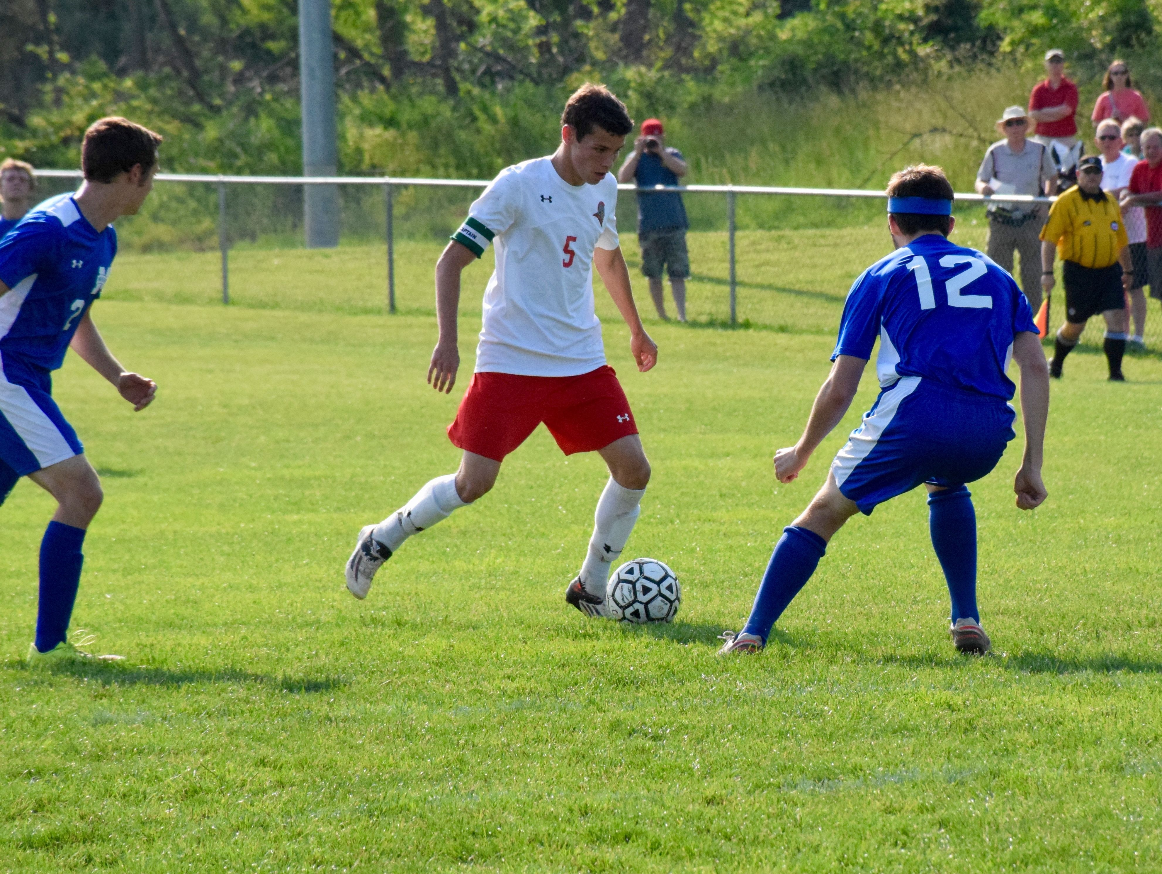 Riverheads' Elijah Knopp works against Mathews' Timothy White during the first half of the Gladiators' Region 1A East semifinal on Wednesday, June 1, 2016, at Riverheads High School in Greenville.