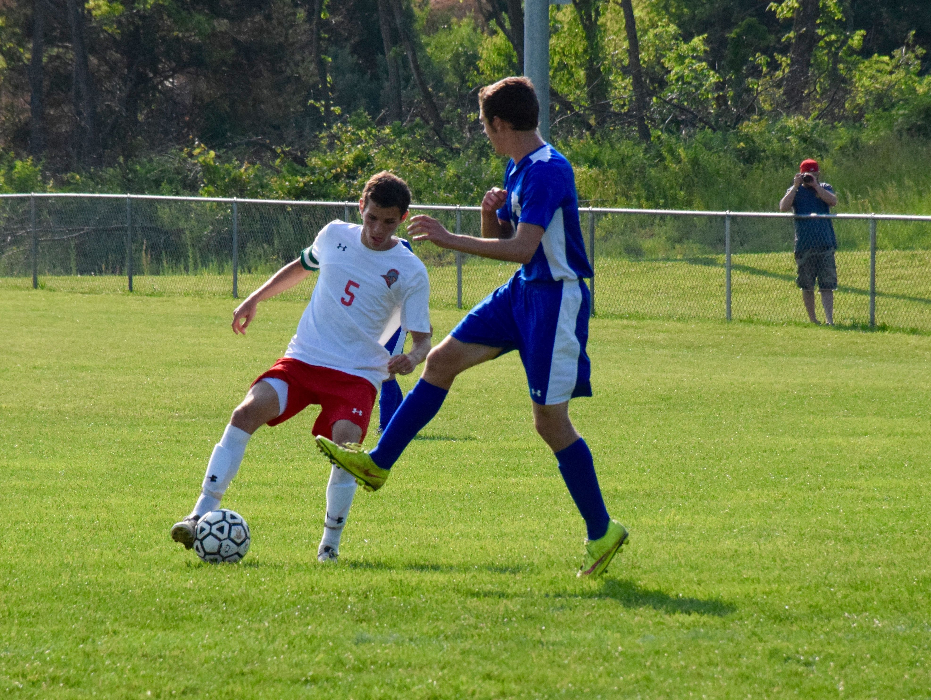 Riverheads' Elijah Knopp works for an opening in the first half of the Gladiators' Region 1A East semifinals against Mathews on Wednesday, June 1, 2016, at Riverheads High School in Greenville.