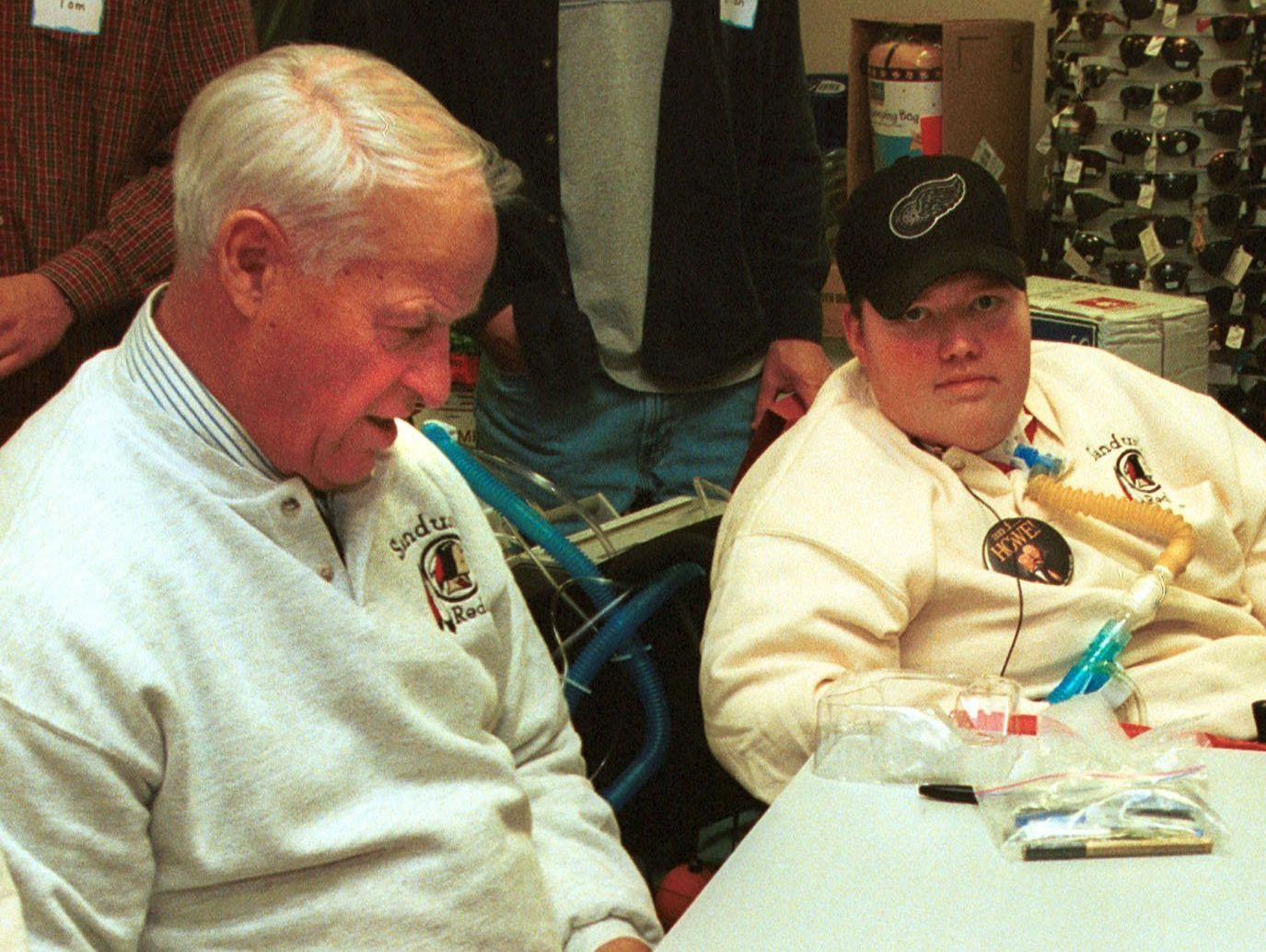 Gordie Howe meets with Sandusky's Steven Kirkpatrick, who battled muscular dystrophy, on December 22, 1999.