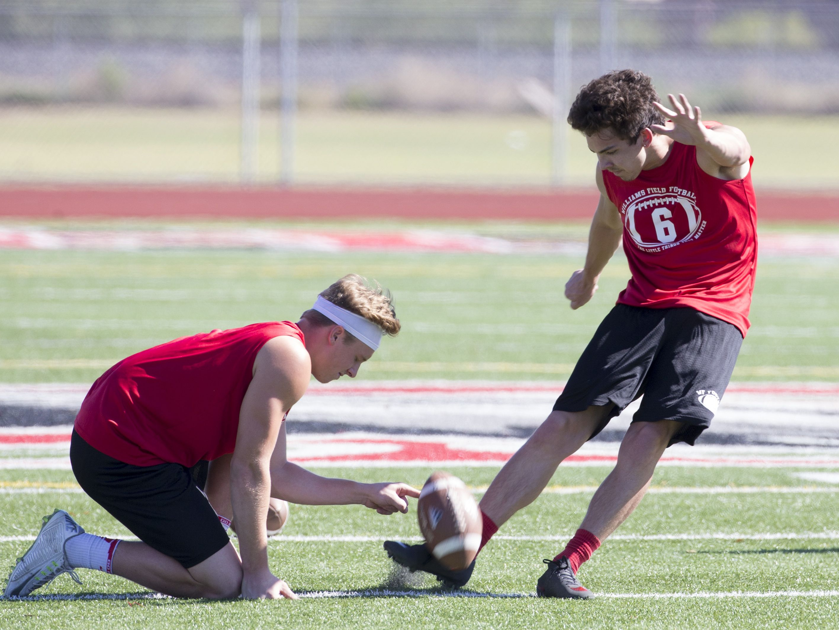 Williams Field High School kicker Brandon Ruiz works out during spring football practice in Gilbert on May 19, 2016.