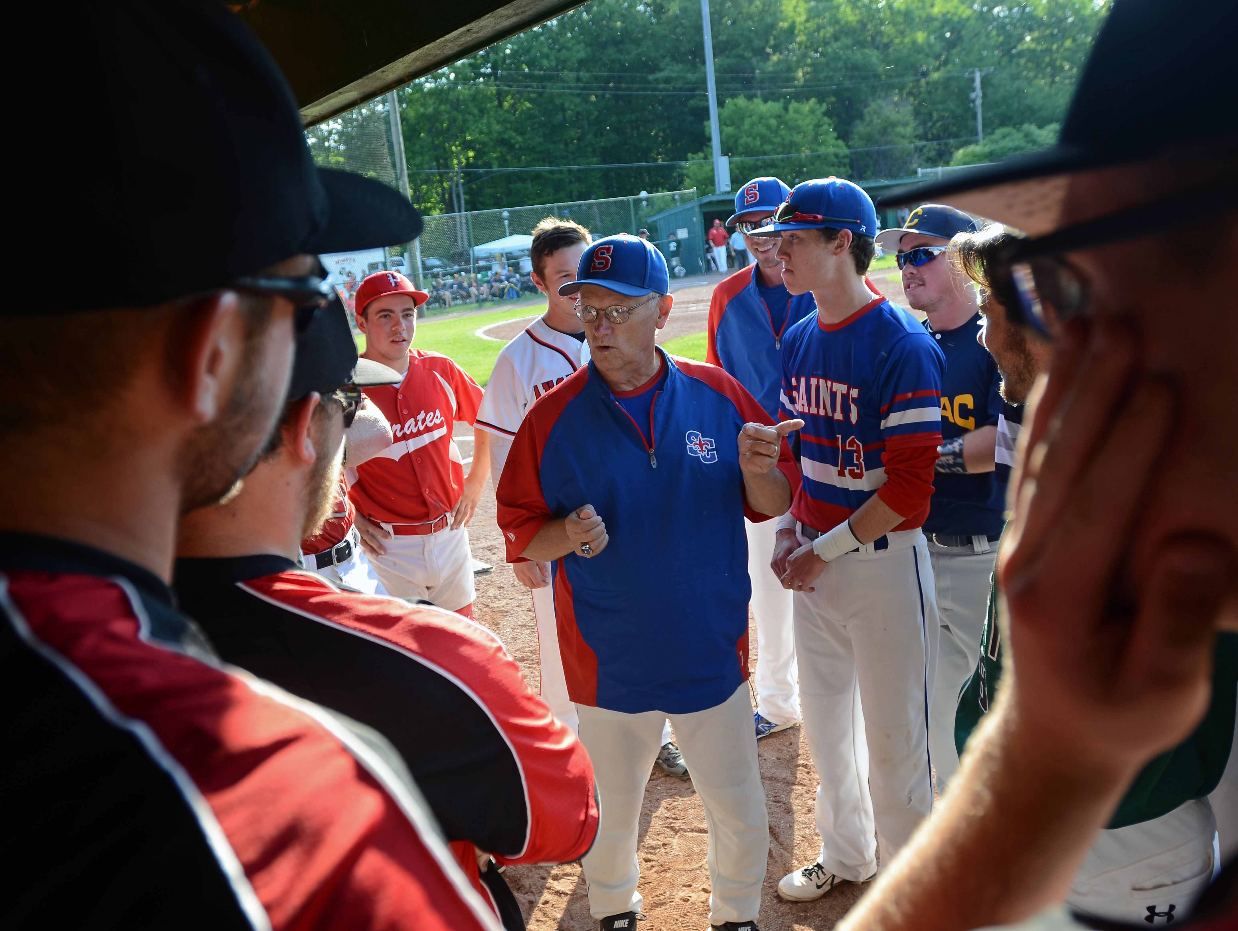 St. Clair coach Denny White says a few words to his Blue Team Monday, June 19, before the SC4 Blue Water Area All-Star Game at Sanborn Park.