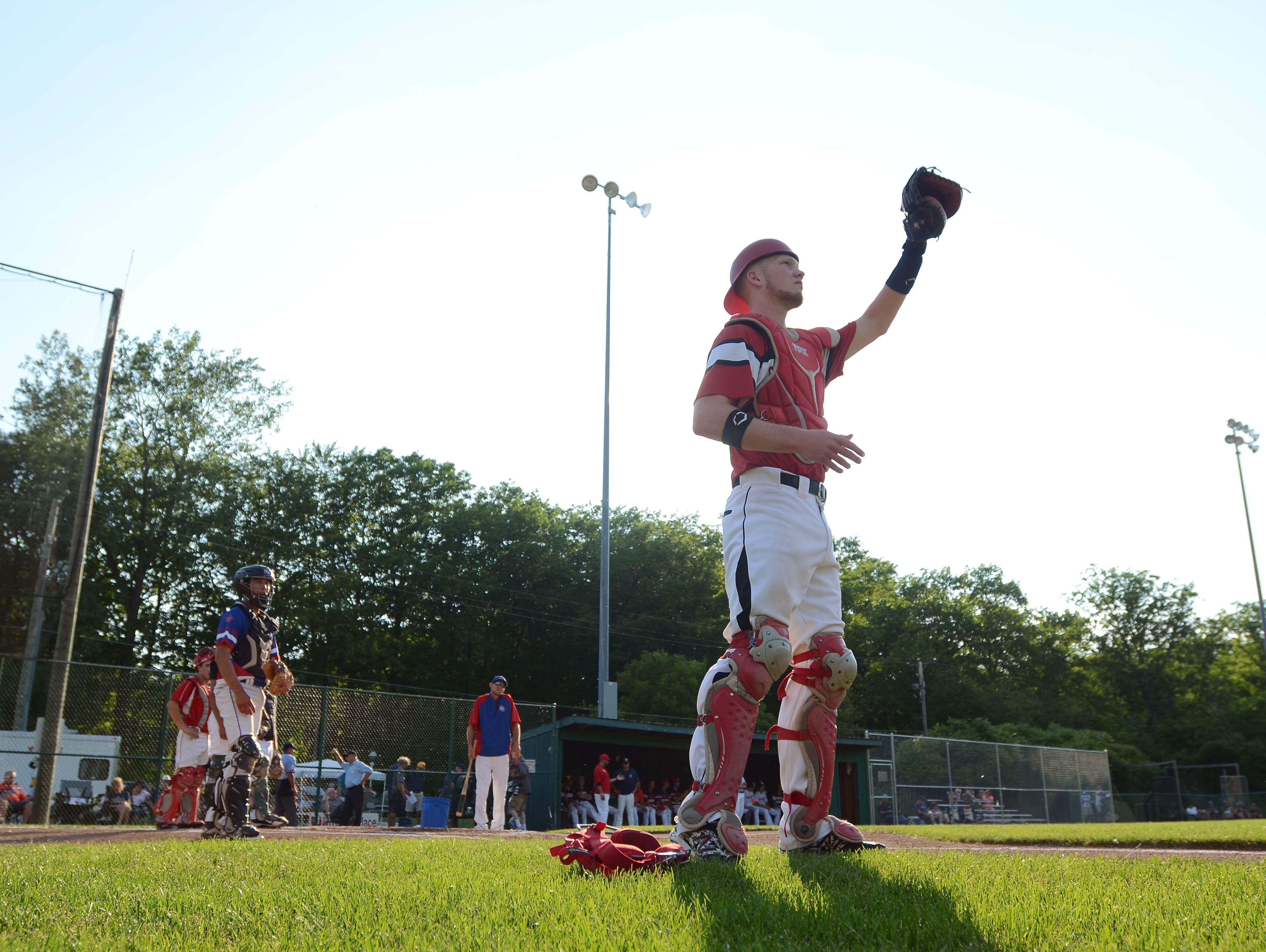 Catcher Noah Moore, of Anchor Bay, warms up with his team Monday, June 19, during the SC4 Blue Water Area All-Star Game at Sanborn Park.