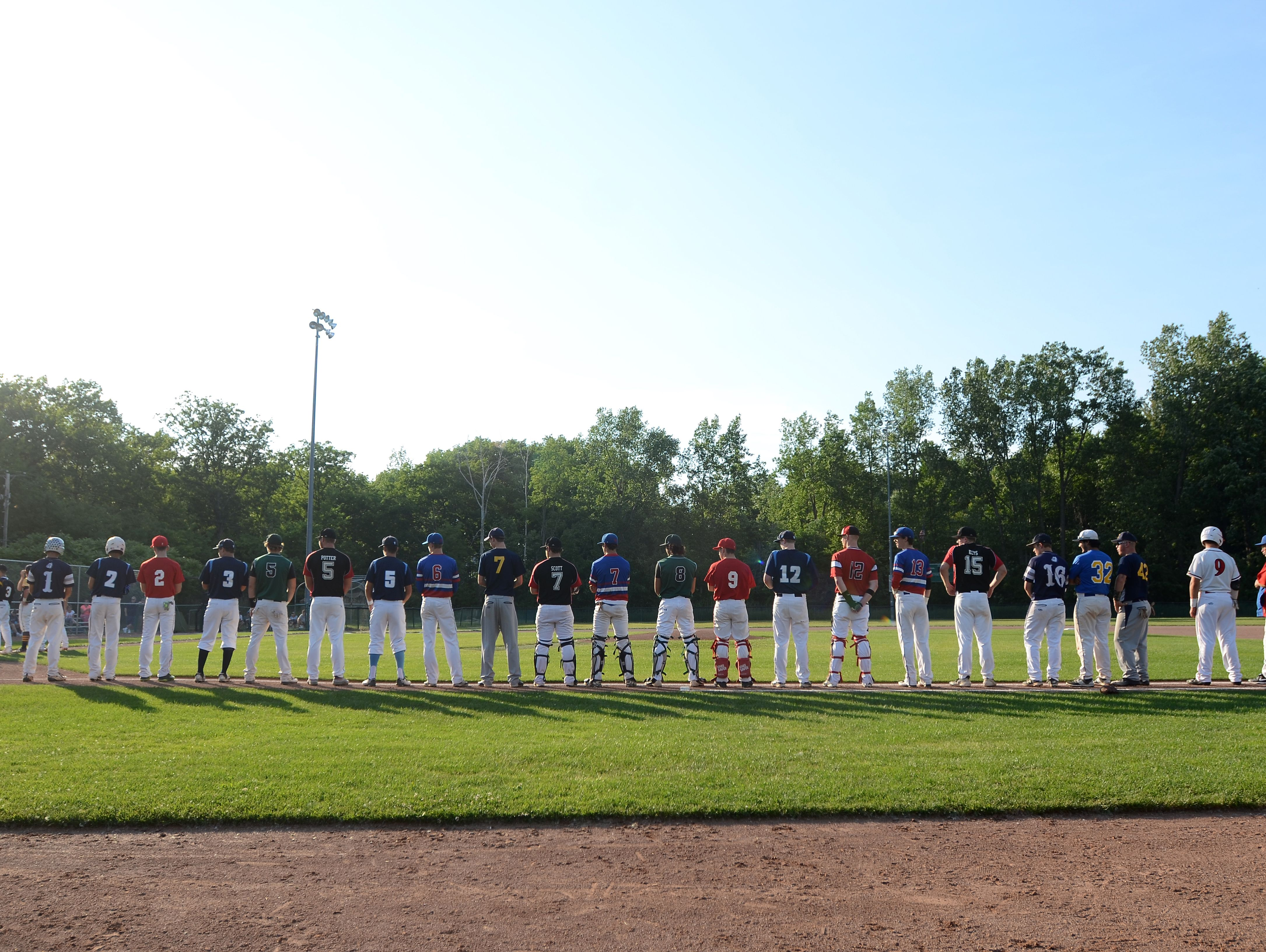 Members of the Blue Team line up during the national anthem Monday, June 19, during the SC4 Blue Water Area All-Star Game at Sanborn Park.
