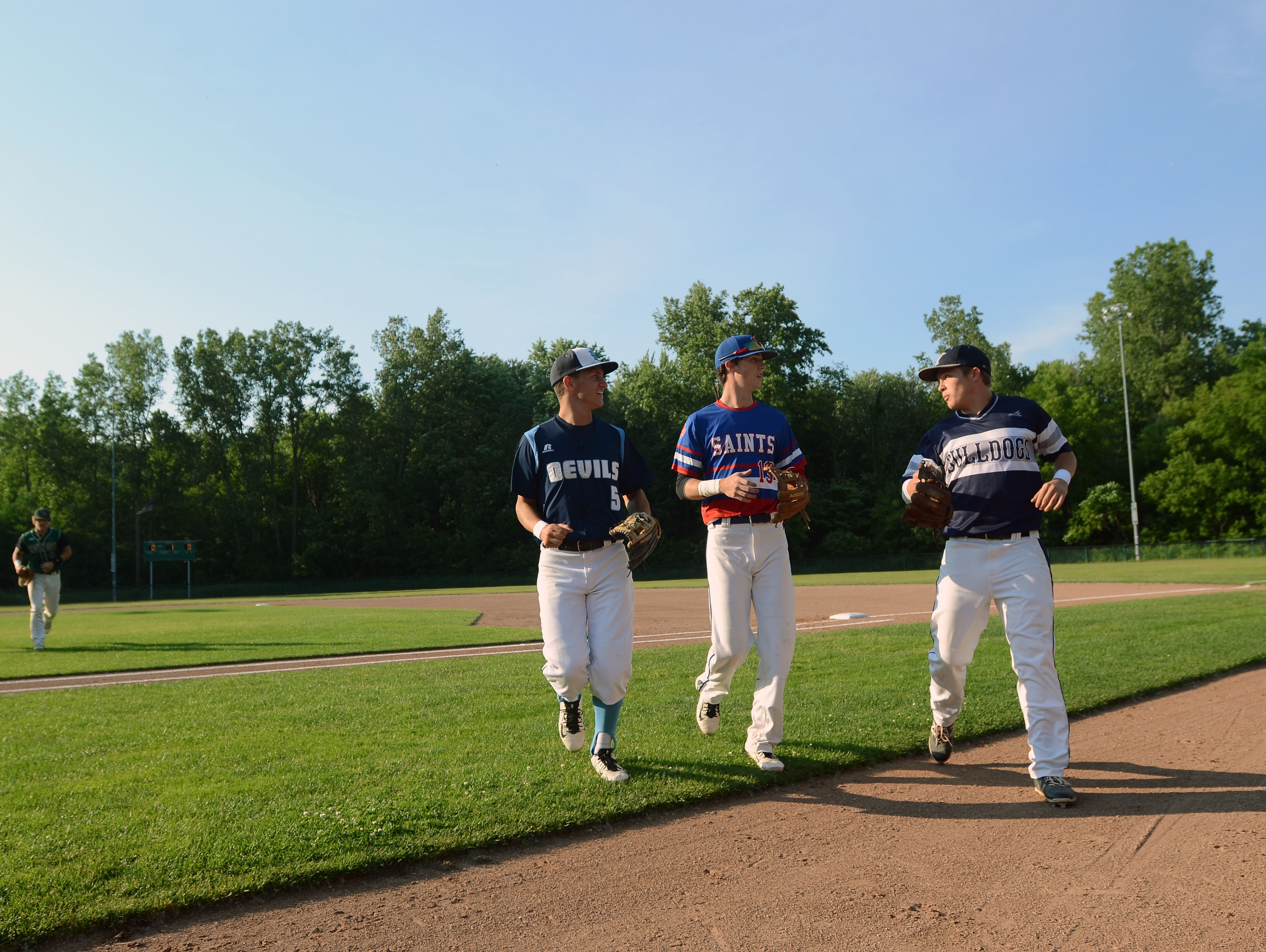 Richmonds' Matt Skoryanc chats with St. Clairs' Brendan Marino and Yales' Kyle Avery Monday, June 19, during the SC4 Blue Water Area All-Star Game at Sanborn Park.