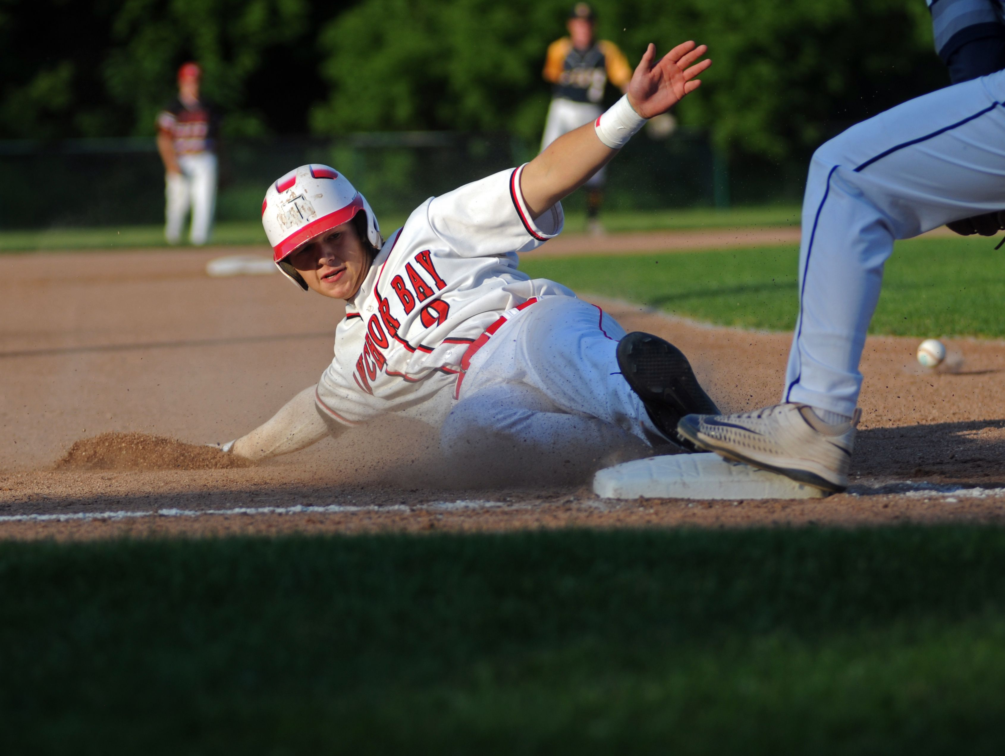 Anchor Bay Tars' Zach Capaldi slides safely into third base Monday, June 19, during the SC4 Blue Water Area All-Star Game at Sanborn Park.