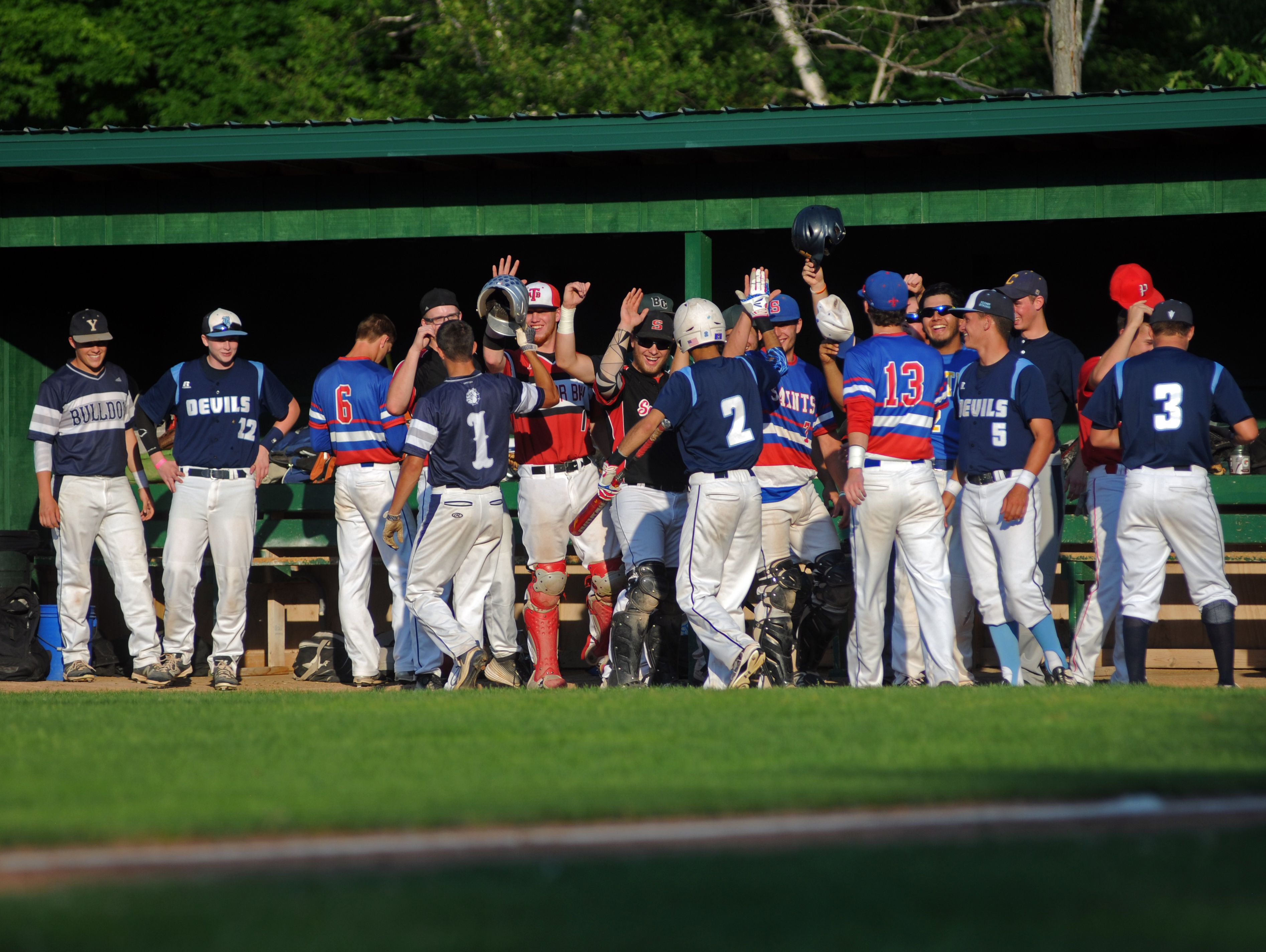 Members of the Blue Team congratulate Richmonds' Stefan Fenwick for earning a run Monday, June 19, during the SC4 Blue Water Area All-Star Game at Sanborn Park.