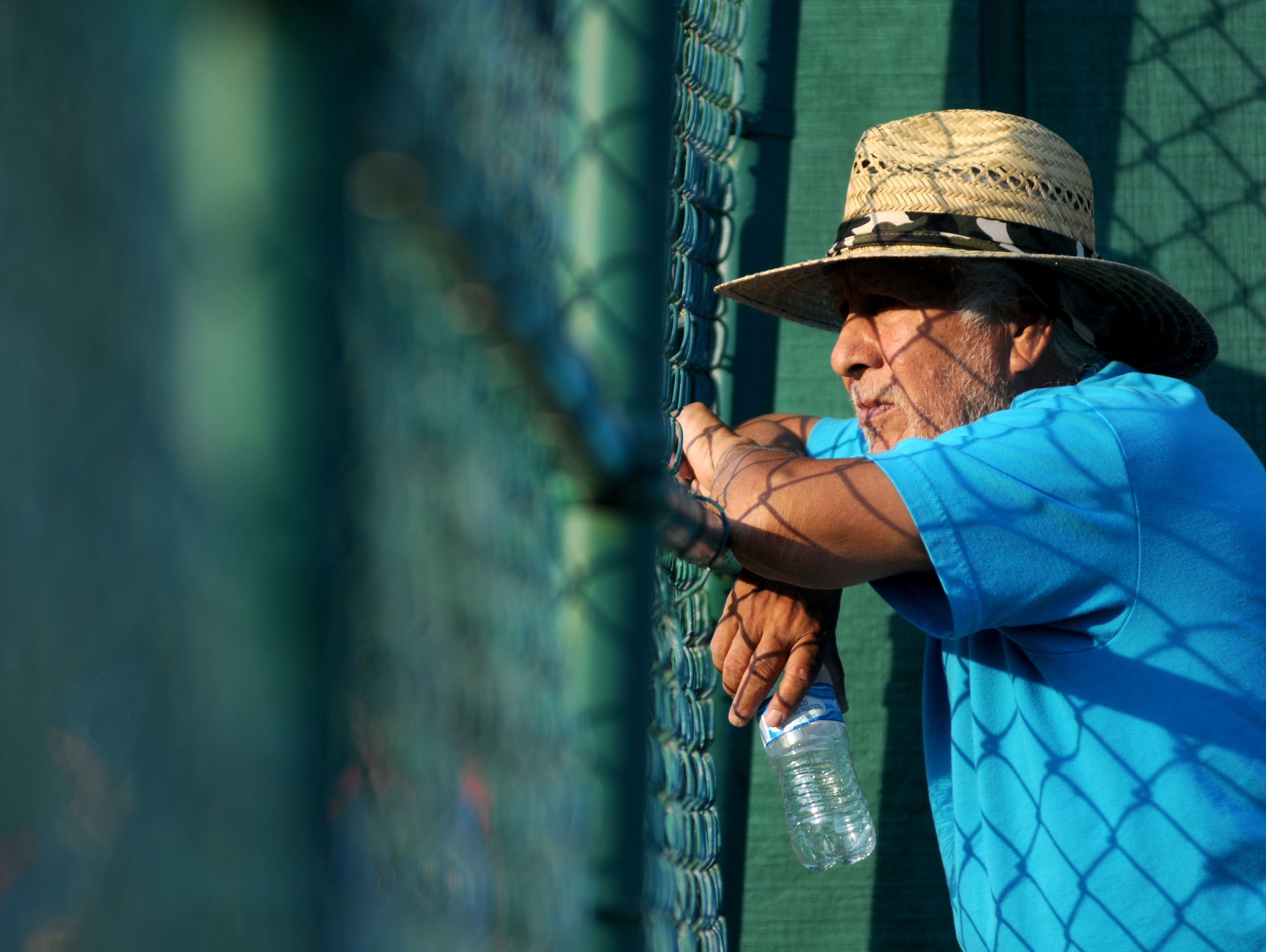 Nacho Ramirez, of Imlay City, watches the game Monday, June 19, during the SC4 Blue Water Area All-Star Game at Sanborn Park. Ramirez's son Orlando was playing for the Blue Team.