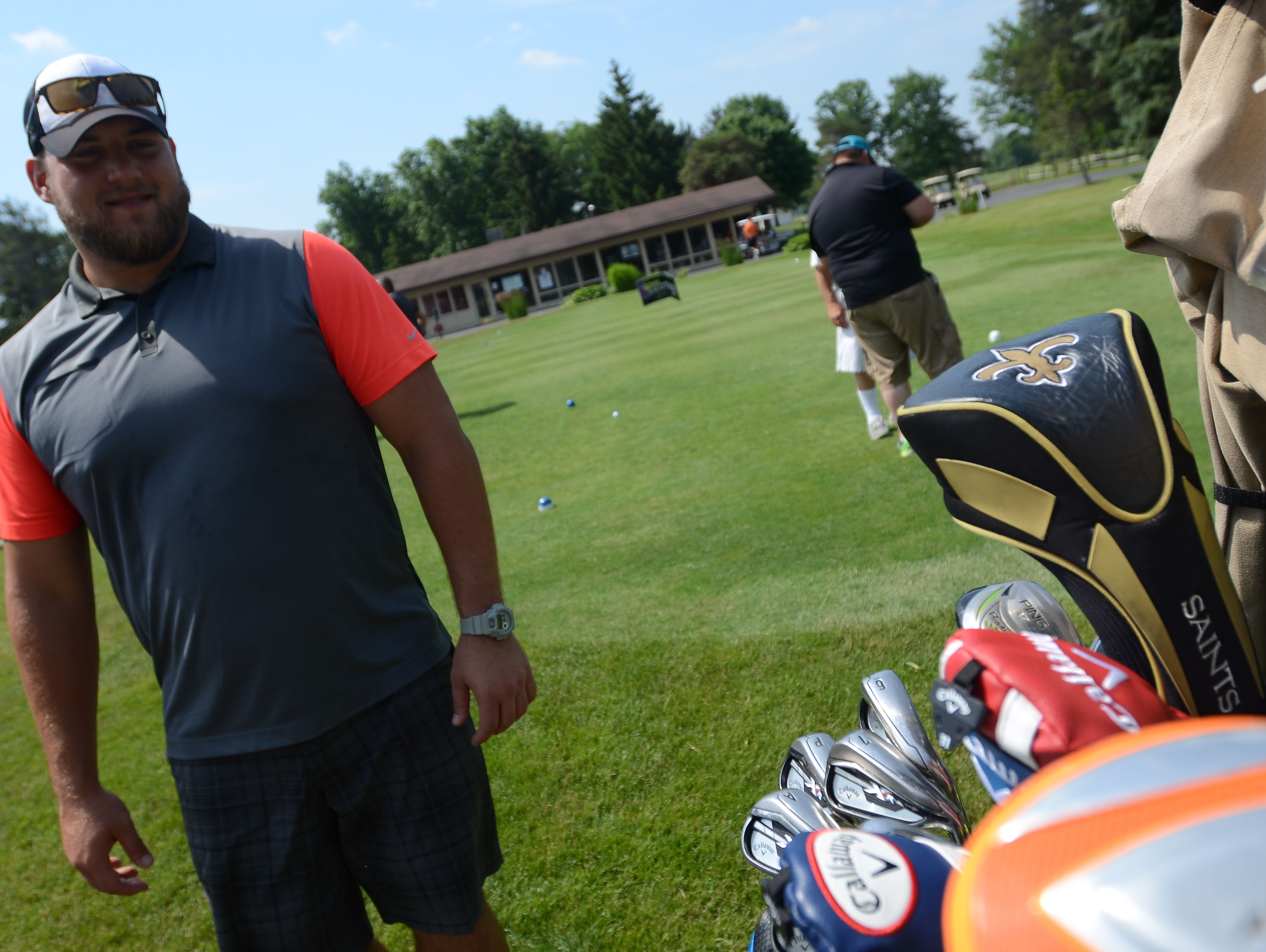 A New Orleans Saints headcover covers Tim Lelito's driver Monday, June 20, during the Lelito Legacy Golf Outing at St. Clair Golf Cub.
