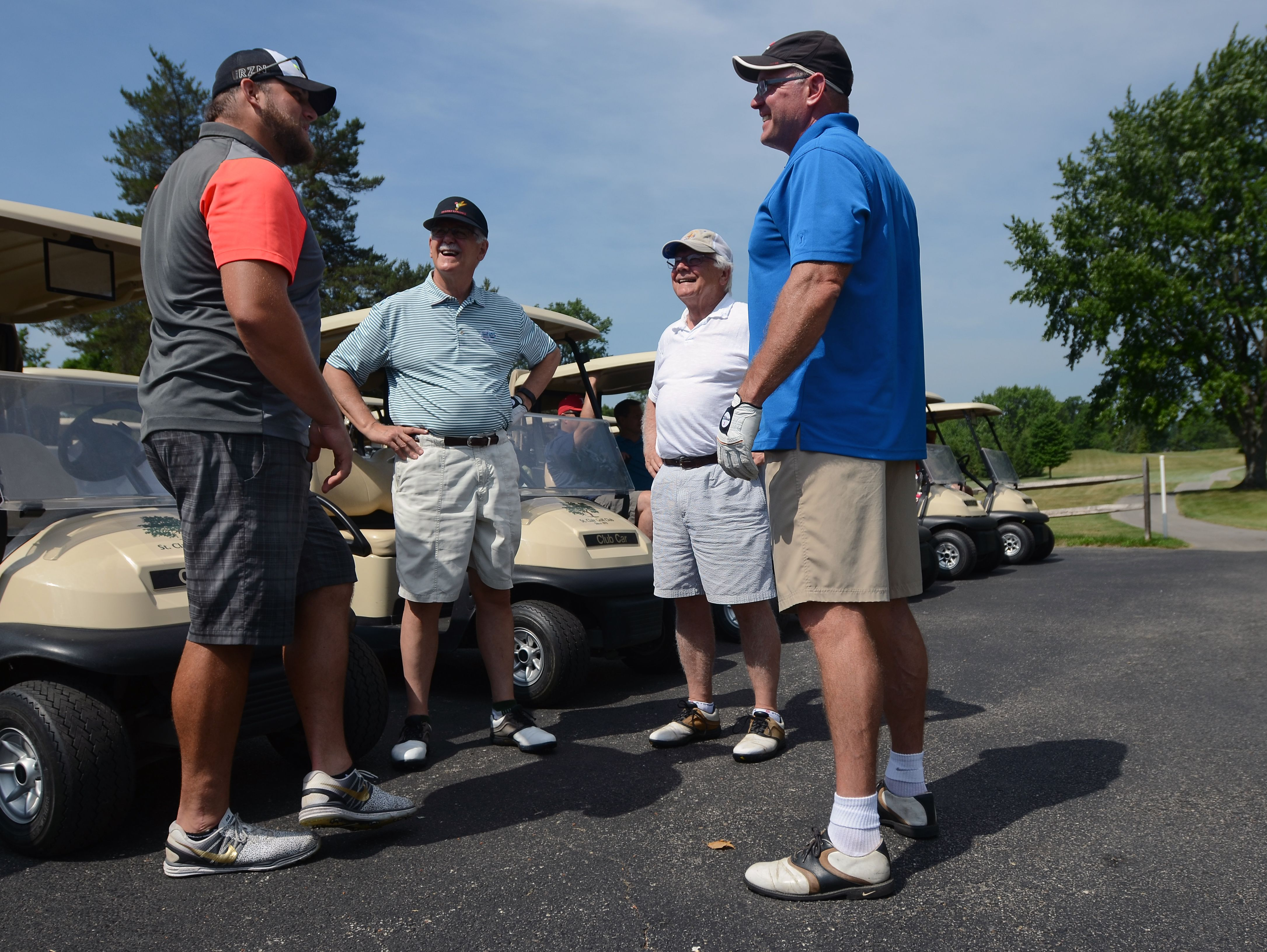 Tim Lelito meets with Jeff Bohm, right, and other members of the outing Monday, June 20, during the Lelito Legacy Golf Outing at St. Clair Golf Cub.