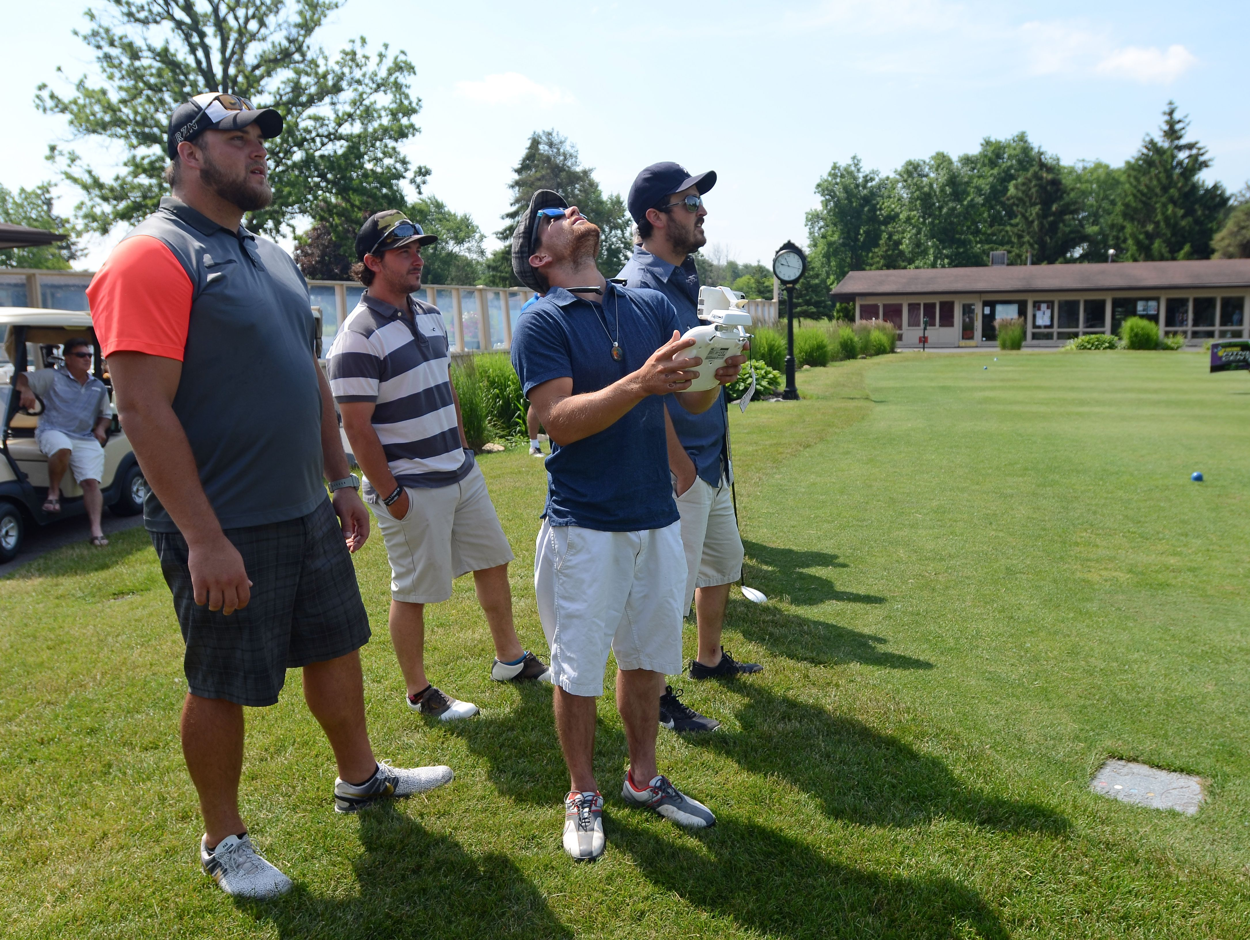 Spencer LaParl takes a group photo with his drone Monday, June 20, during the Lelito Legacy Golf Outing at St. Clair Golf Cub.