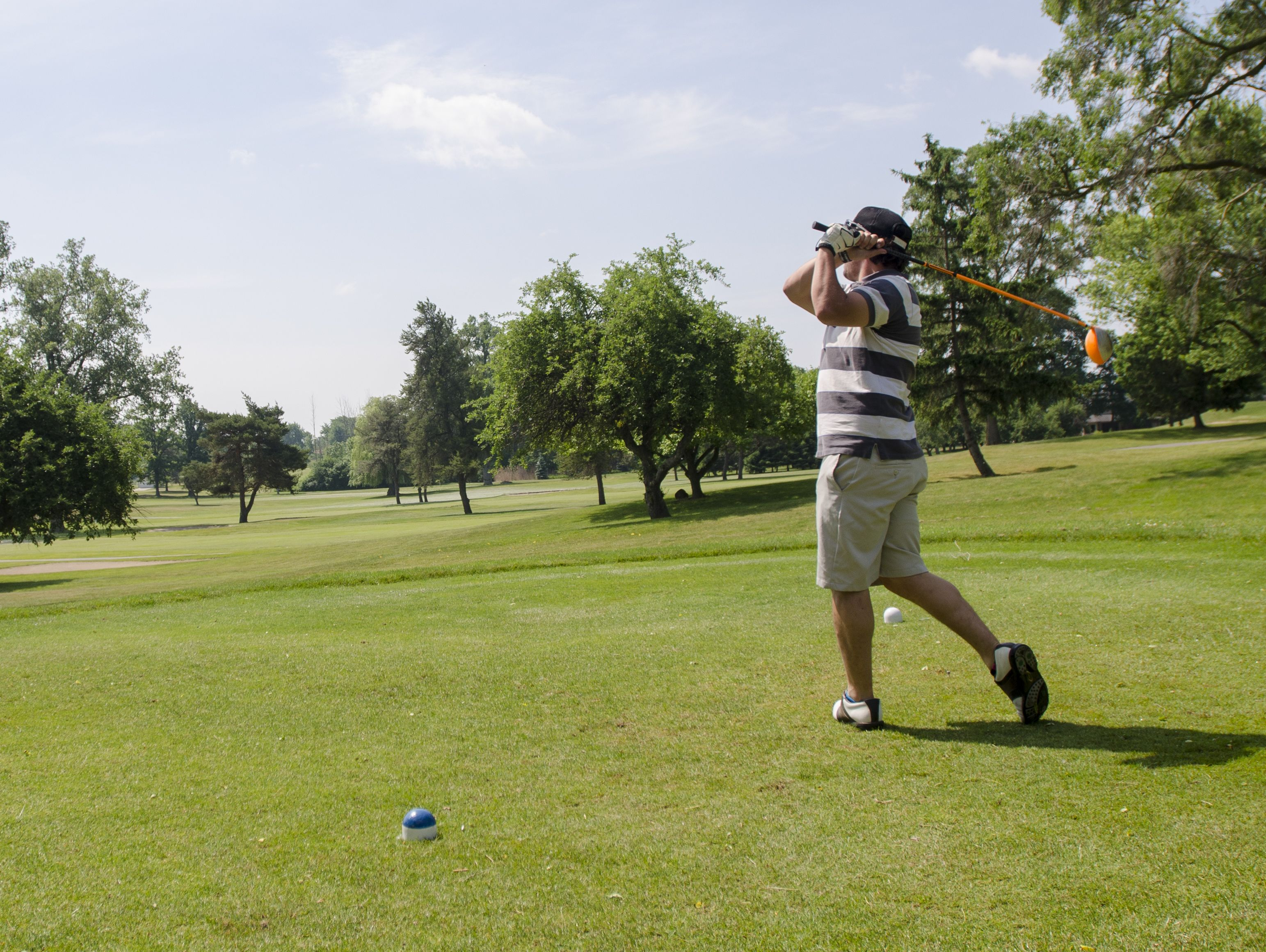 Caleb Mireau, of St. Clair, tees off Monday, June 20, during the Lelito Legacy Golf Outing at St. Clair Golf Cub.