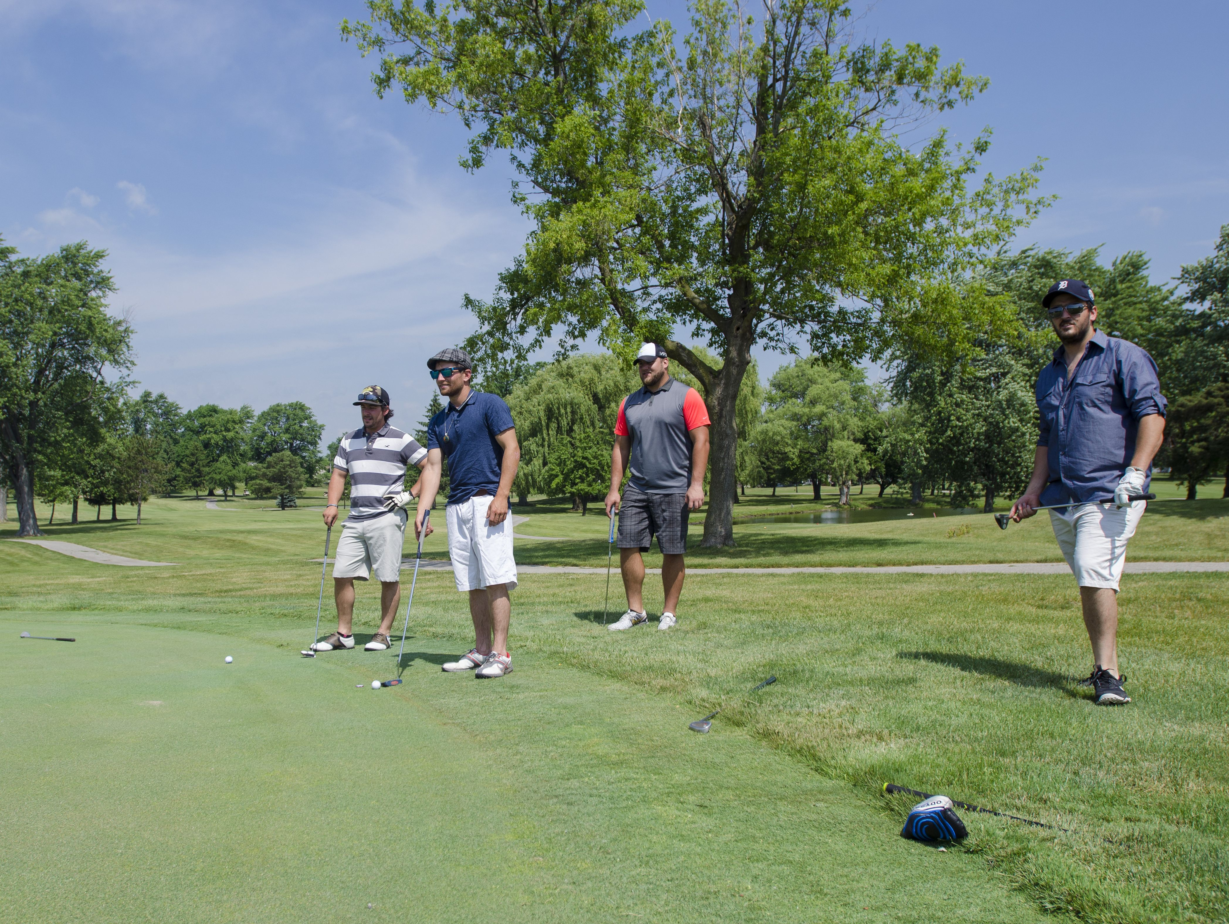 Tim Lelito and his group line up their putts Monday, June 20, during the Lelito Legacy Golf Outing at St. Clair Golf Cub.