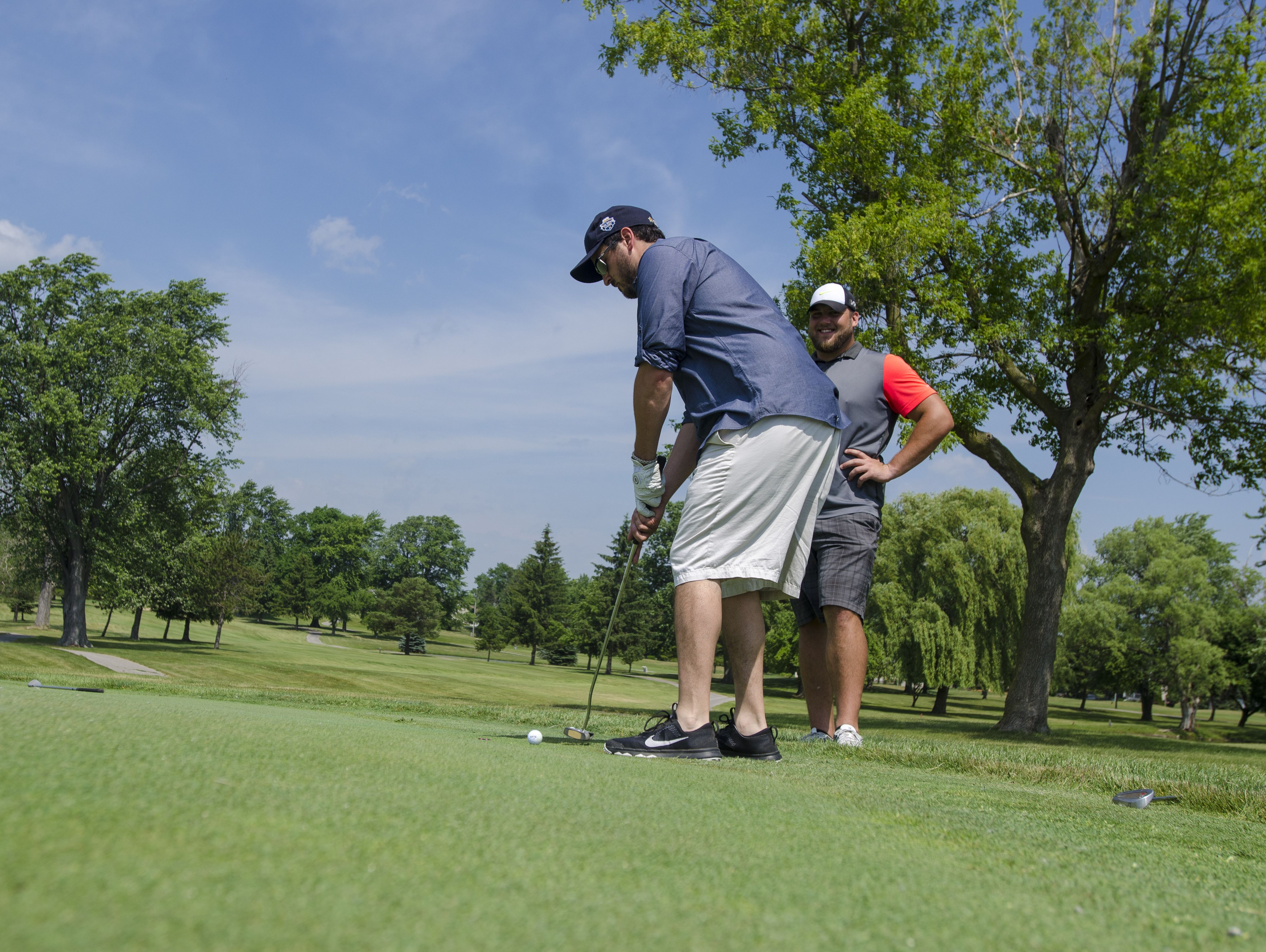 Brent Mireau, of St. Clair, readies his putt Monday, June 20, during the Lelito Legacy Golf Outing at St. Clair Golf Cub.